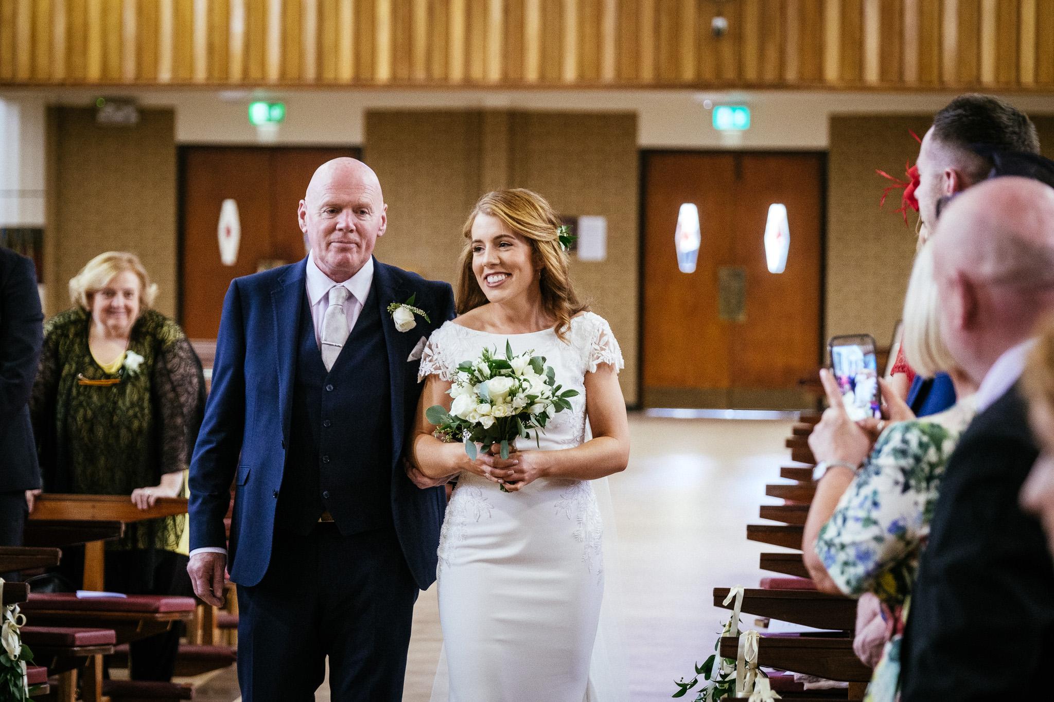 bride walking down aisle in raheny dublin
