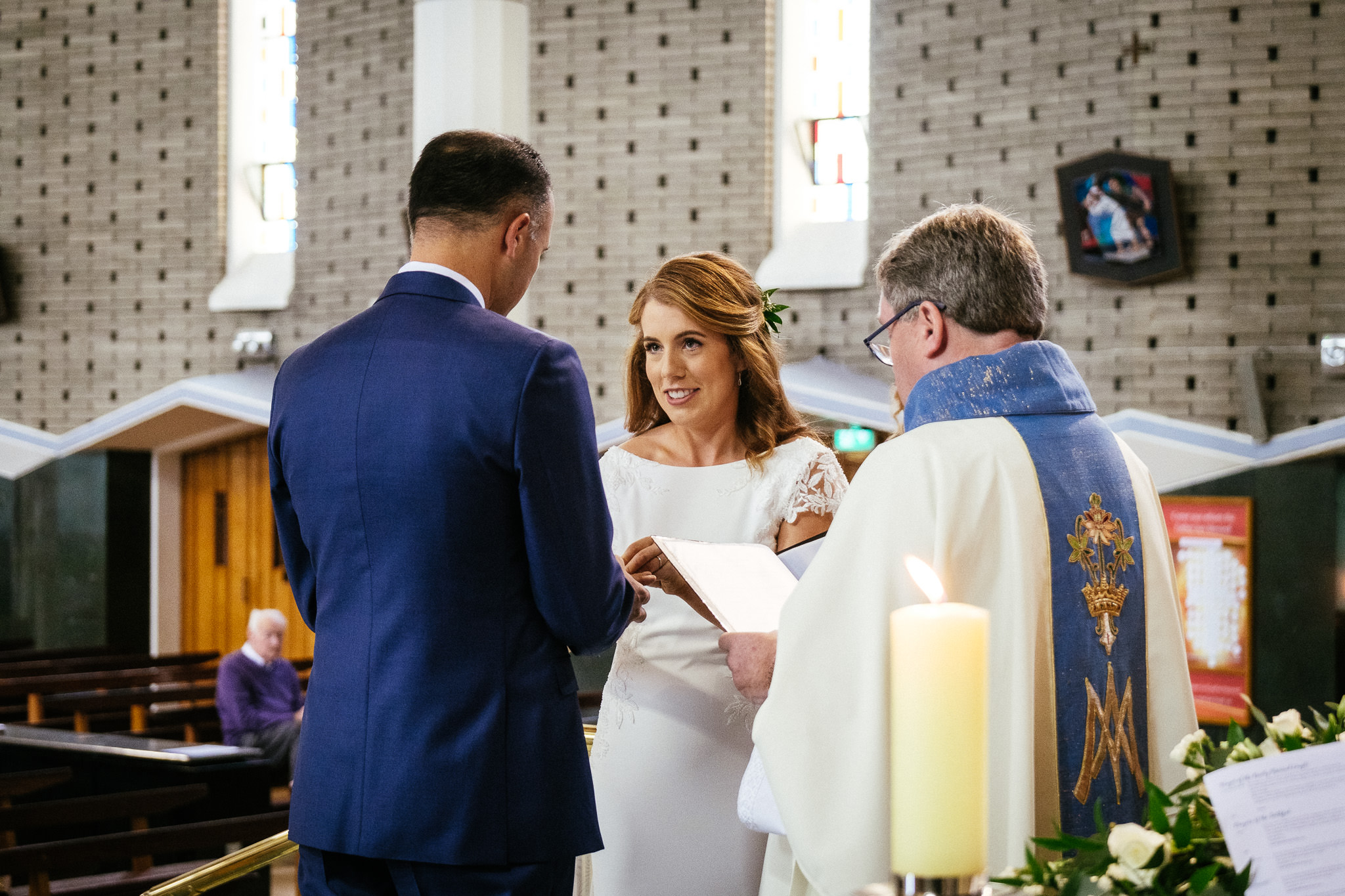 bride and groom exchanging vows in raheny dublin