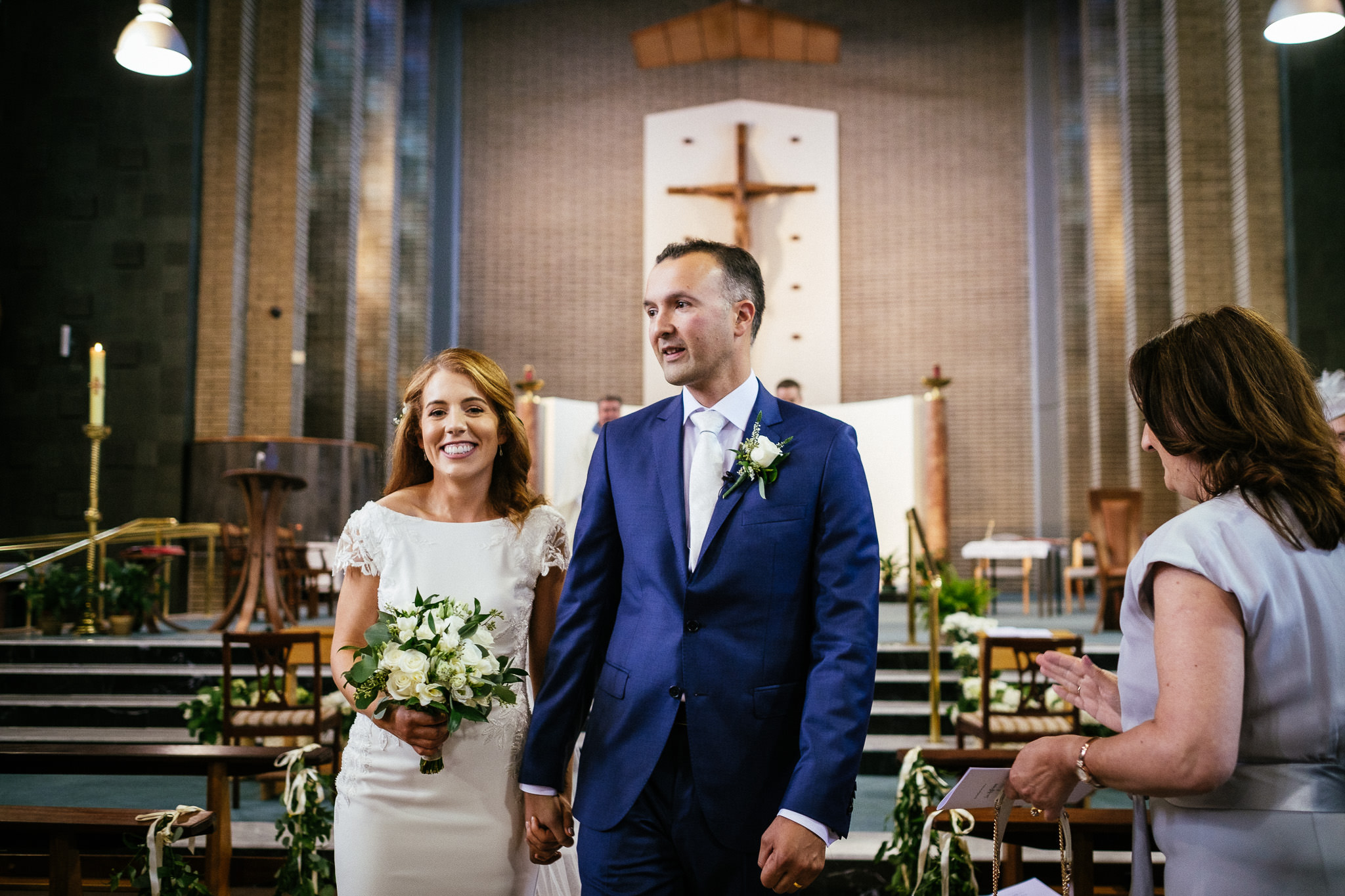 bride and groom leaving the church in raheny dublin