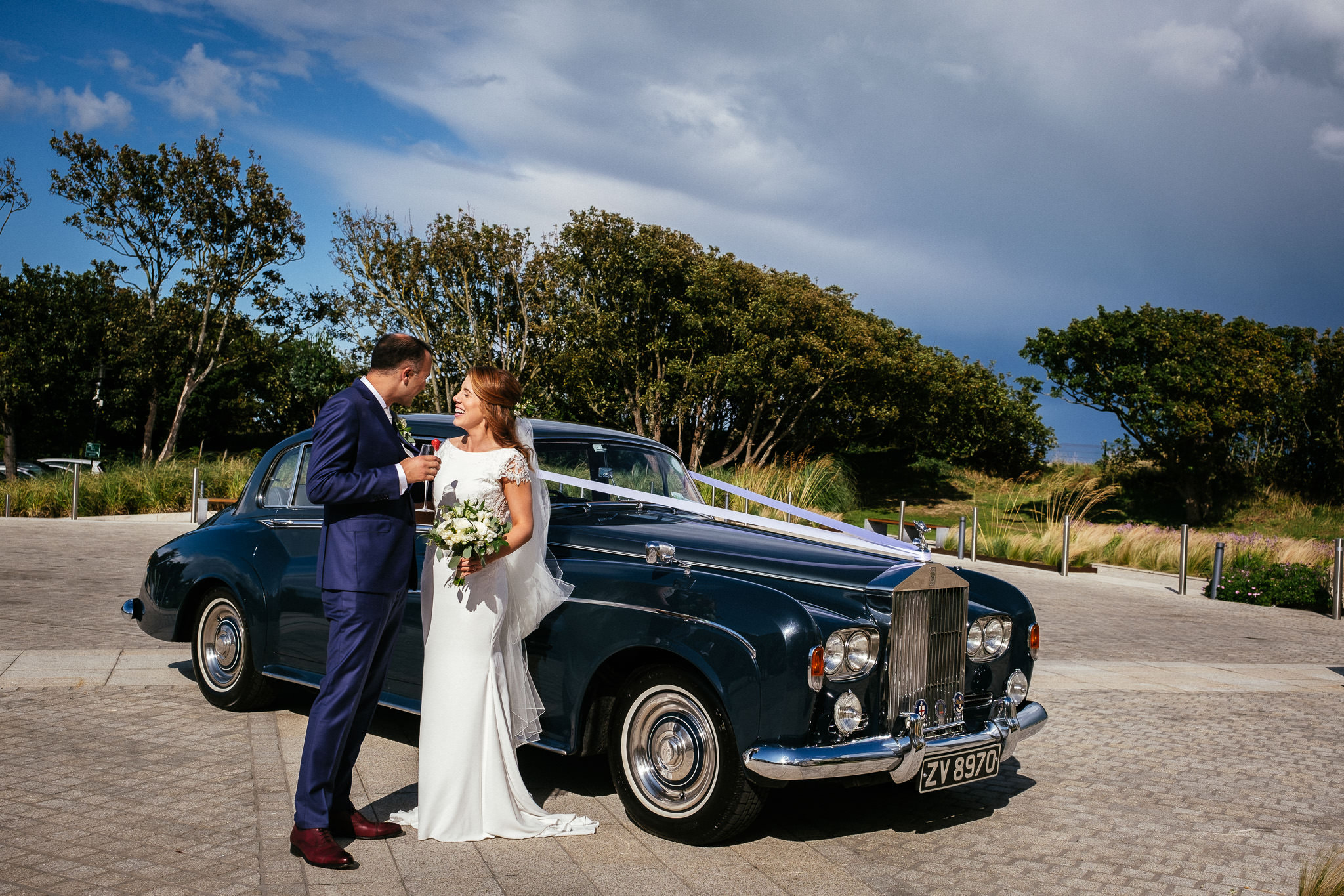 bride and groom arriving by vintage car at their portmarnock hotel wedding