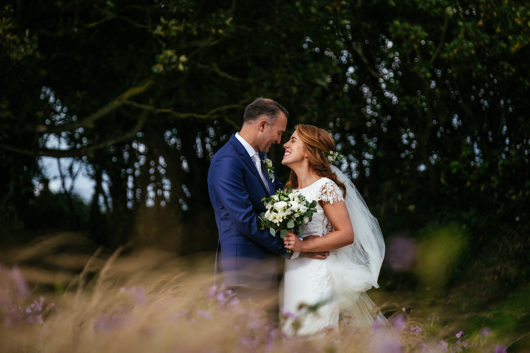 bride and groom in the trees at the Portmarnock Hotel Dublin