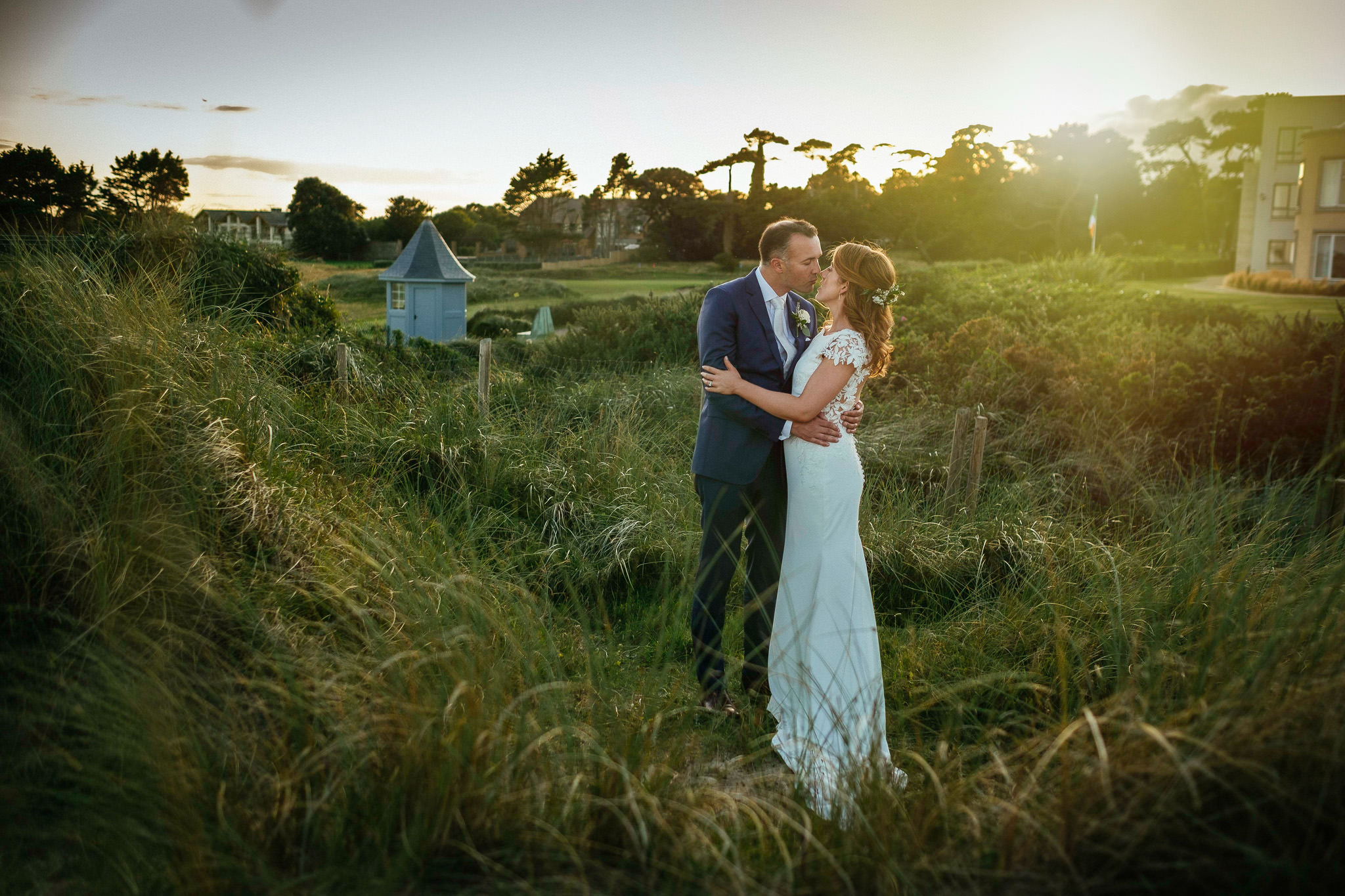 bride and groom embracing at their portmarnock hotel wedding