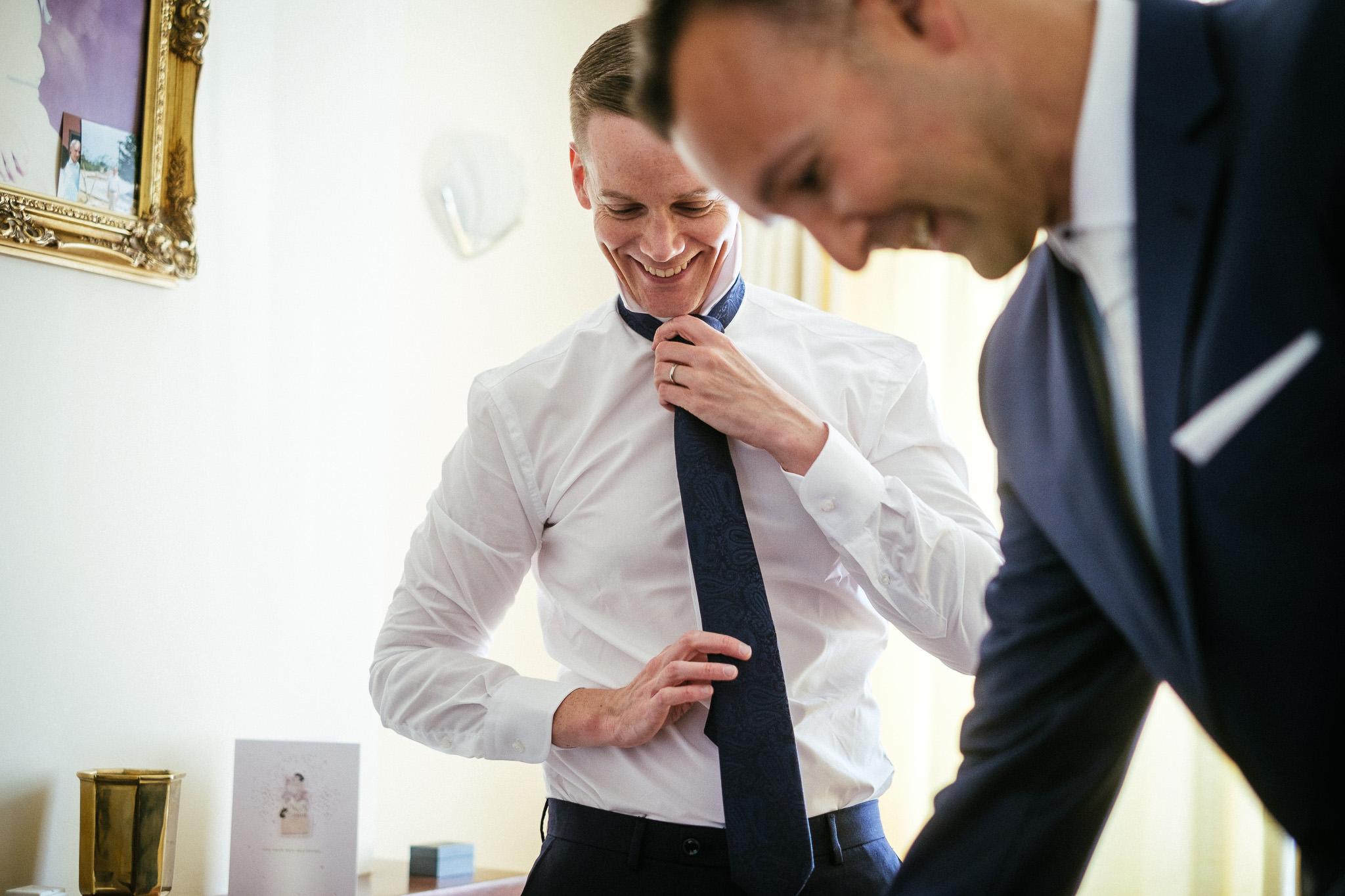 groomsman getting dressed