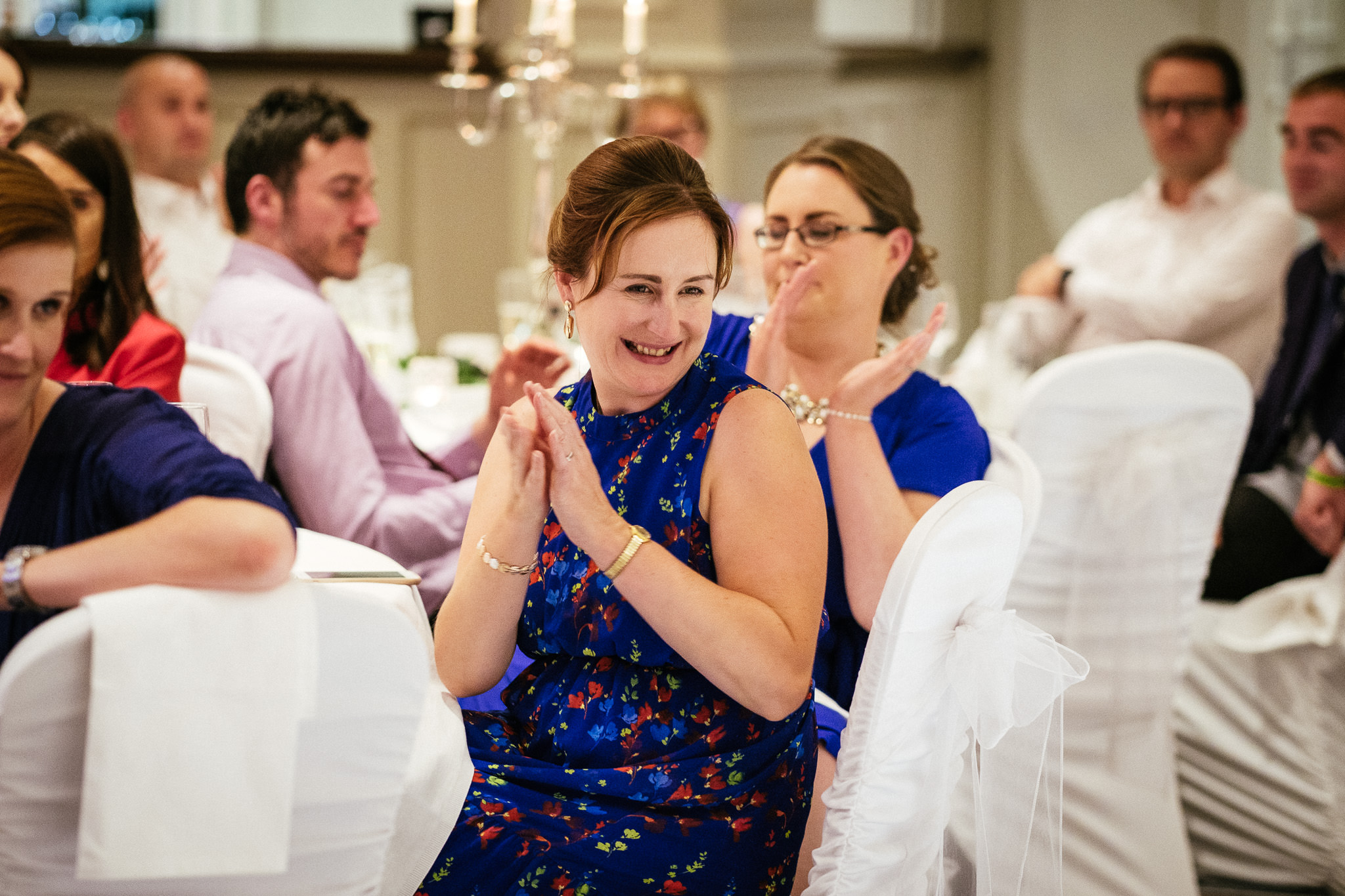 wedding guest clapping hands