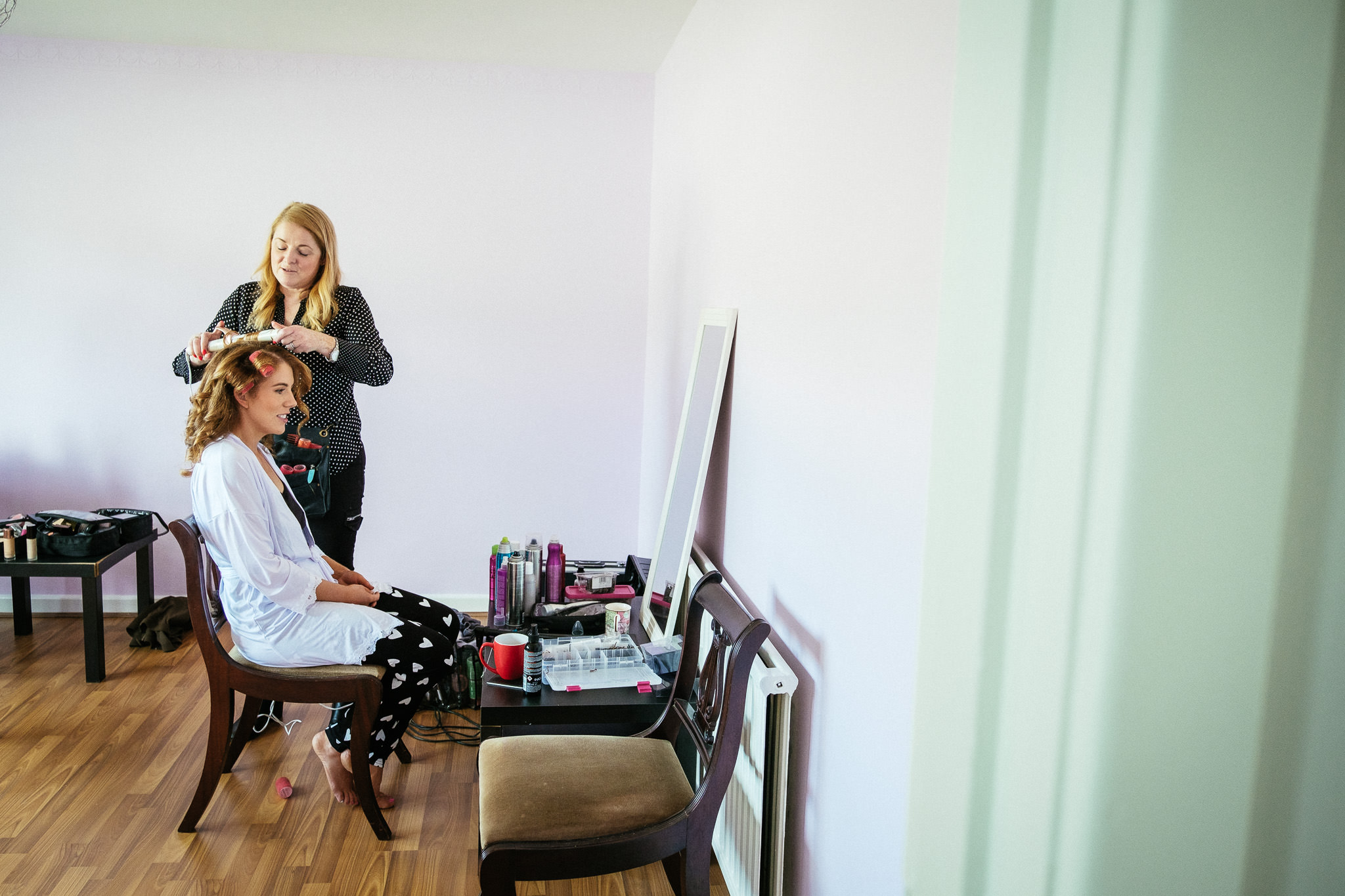 bride getting hair done before her portmarnock hotel wedding