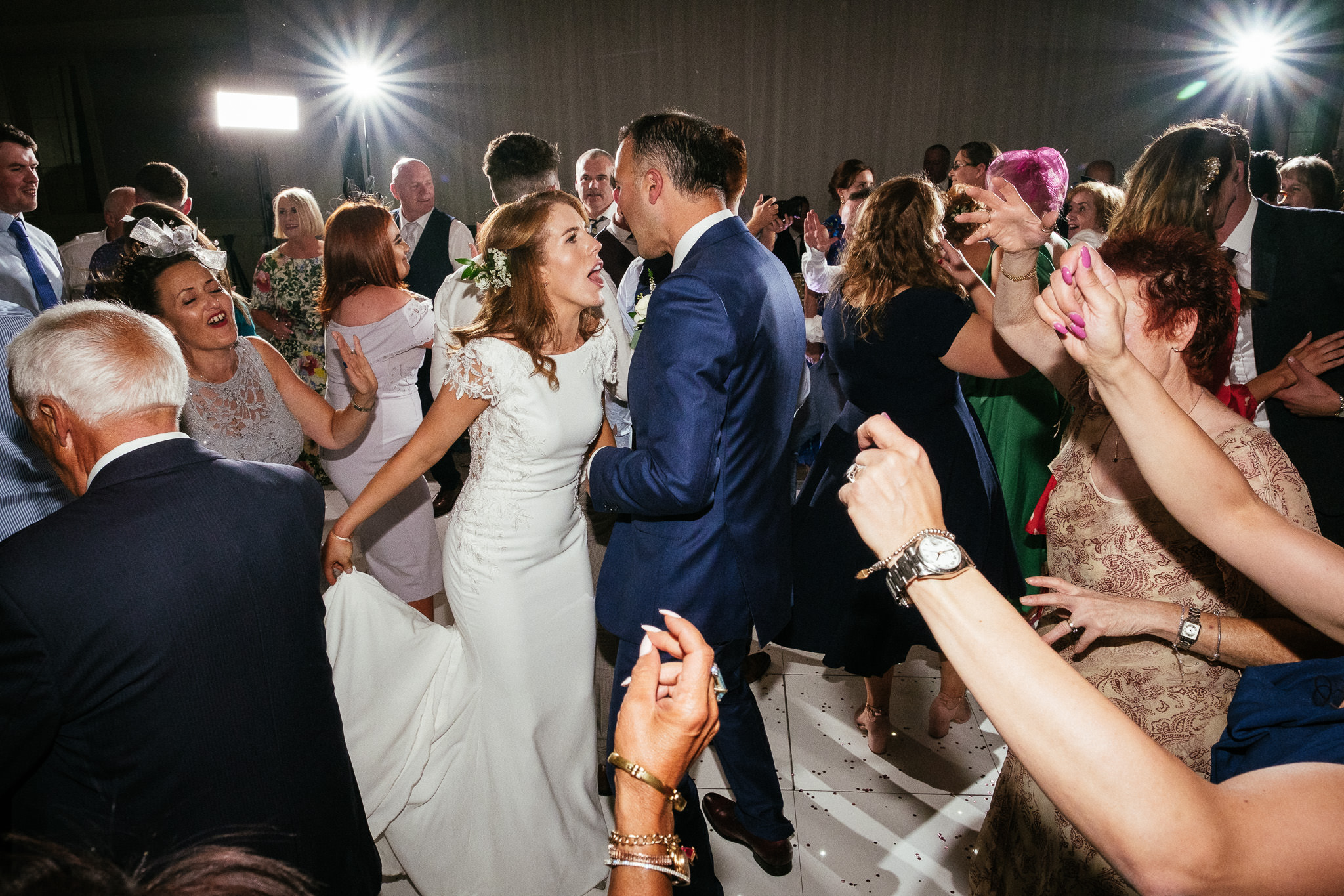 bride and groom singing on dancefloor