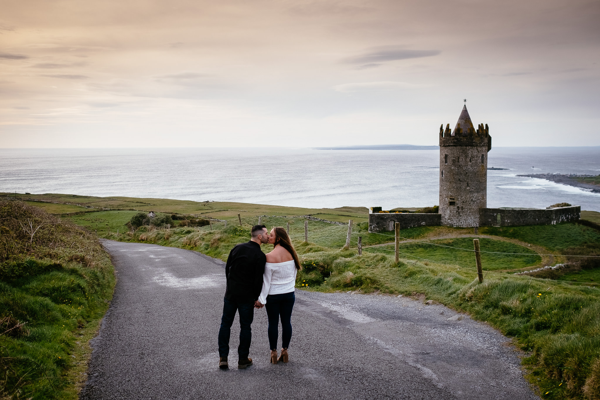 engaged couple kissing at Doolin beside the Cliffs of Moher Ireland