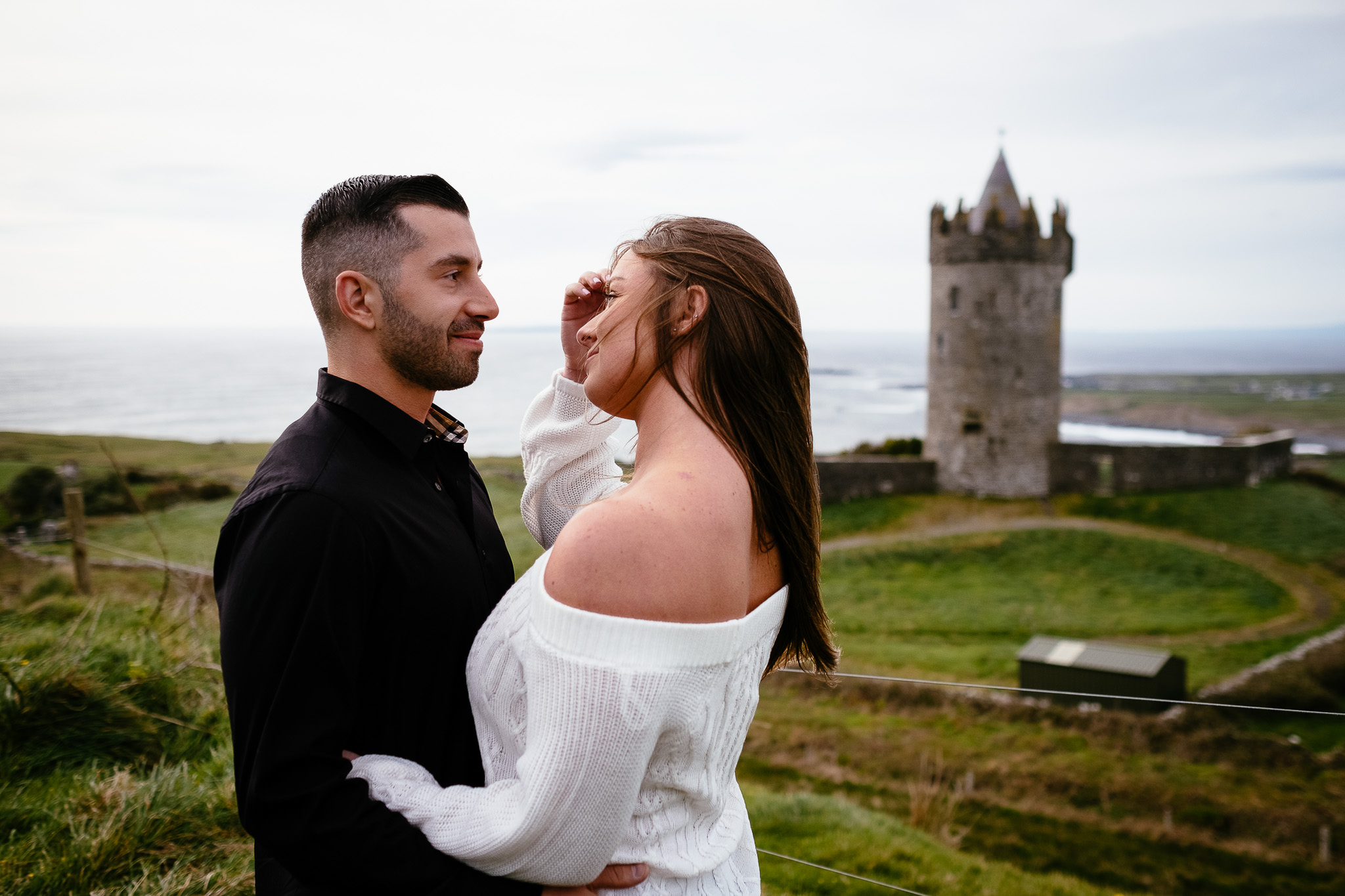 engaged couple talking at Doolin beside the Cliffs of Moher Ireland
