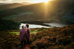 engaged couple kissing on a mountain at one of the Best location in Ireland for an Engagement Shoot or Elopement