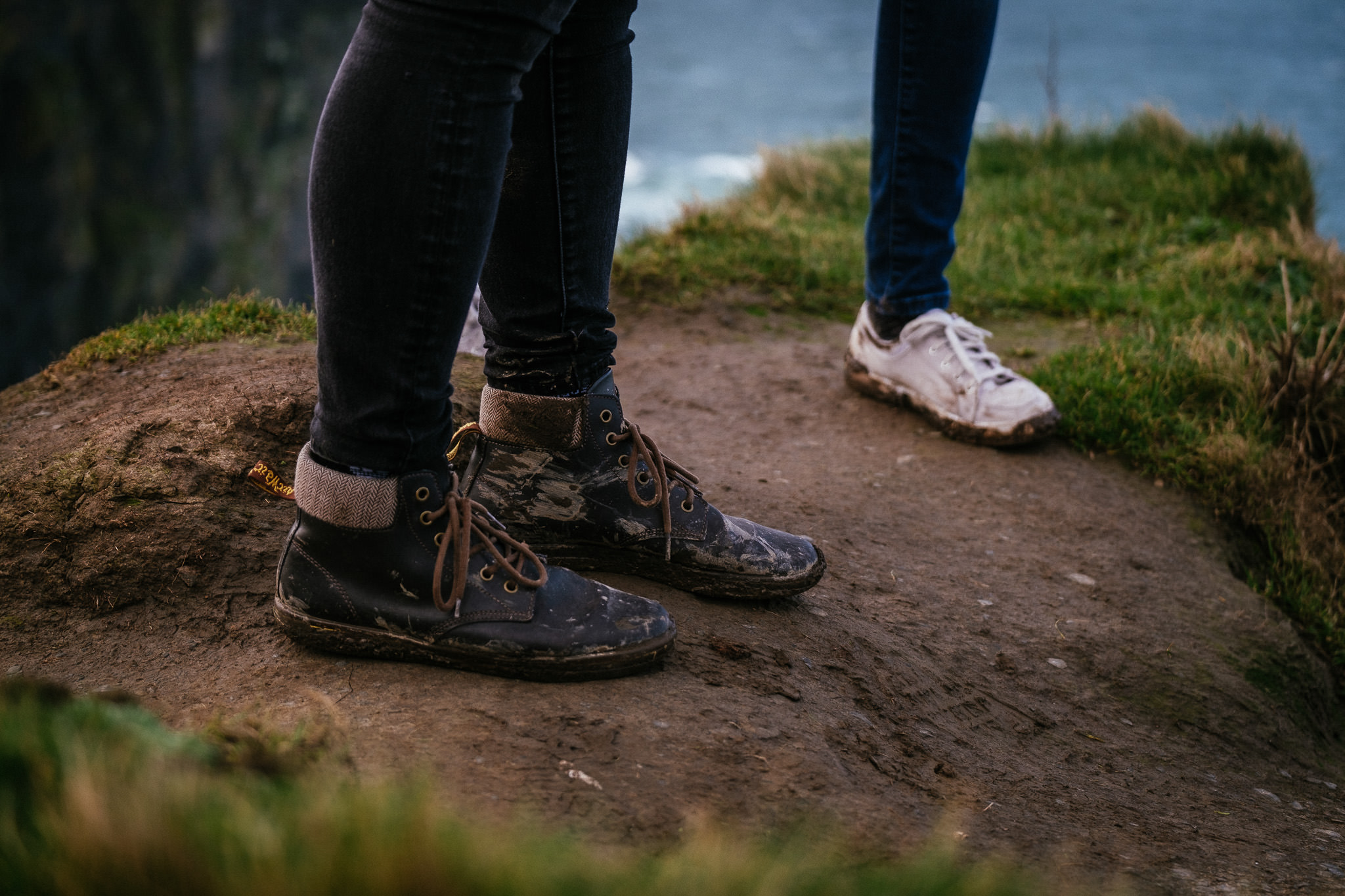 dirty shoes at the Cliffs of Moher Ireland