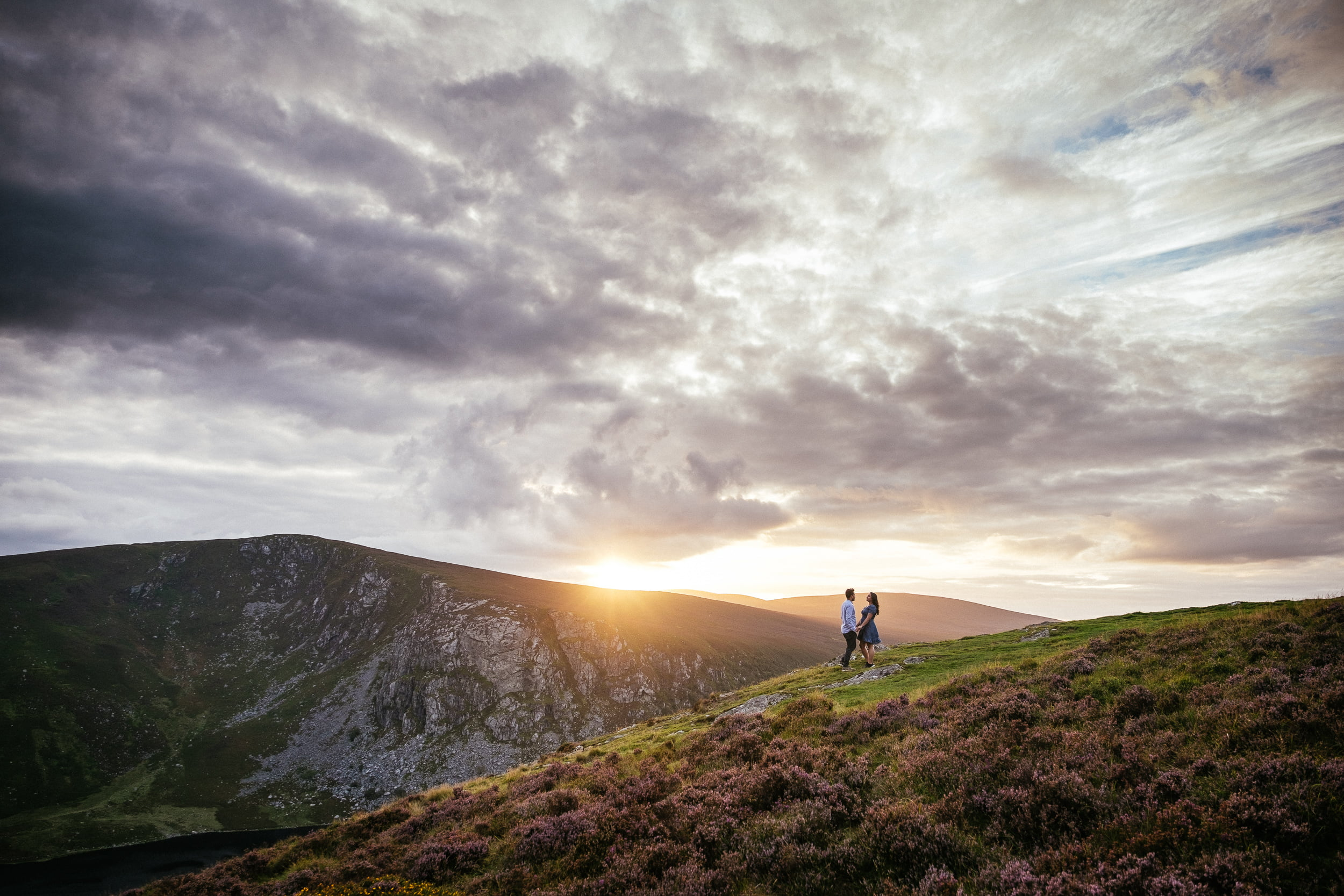 engaged couple on a mountain top at sunset ireland