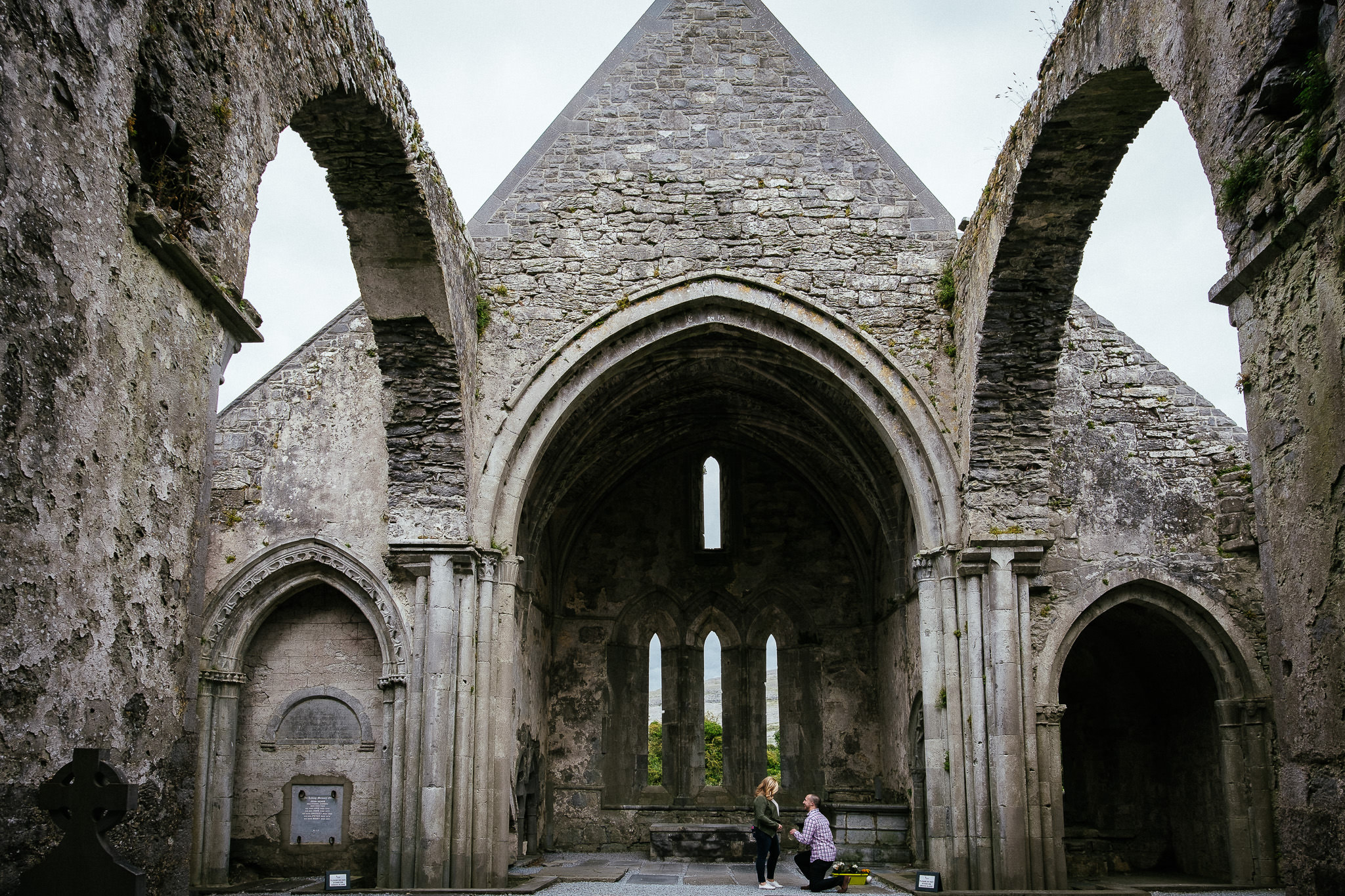 guy proposing to his girlfriend at corcomroe abbey