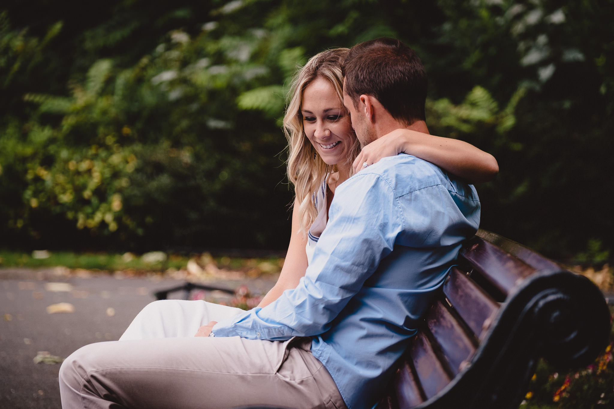 engaged couple laughing during their engagement photo session in St Stephens Green Park Dublin