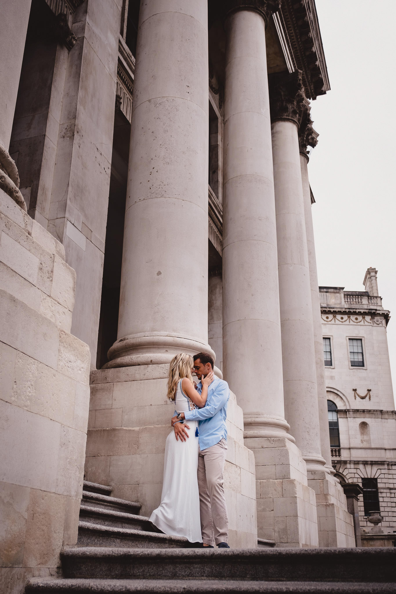 engaged couple posing outside City Hall in Dublin