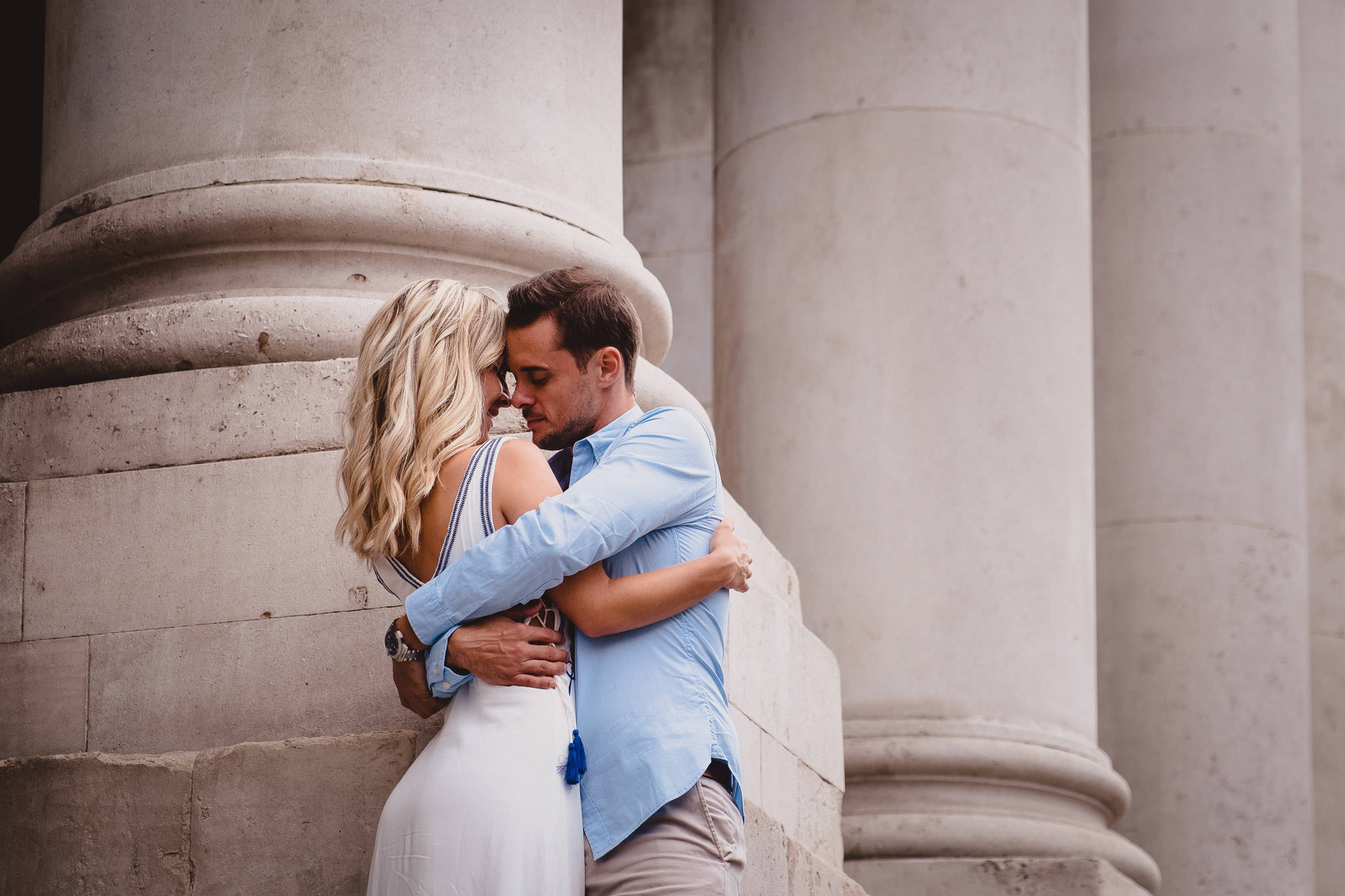 engaged couple hugging outside City Hall in Dublin