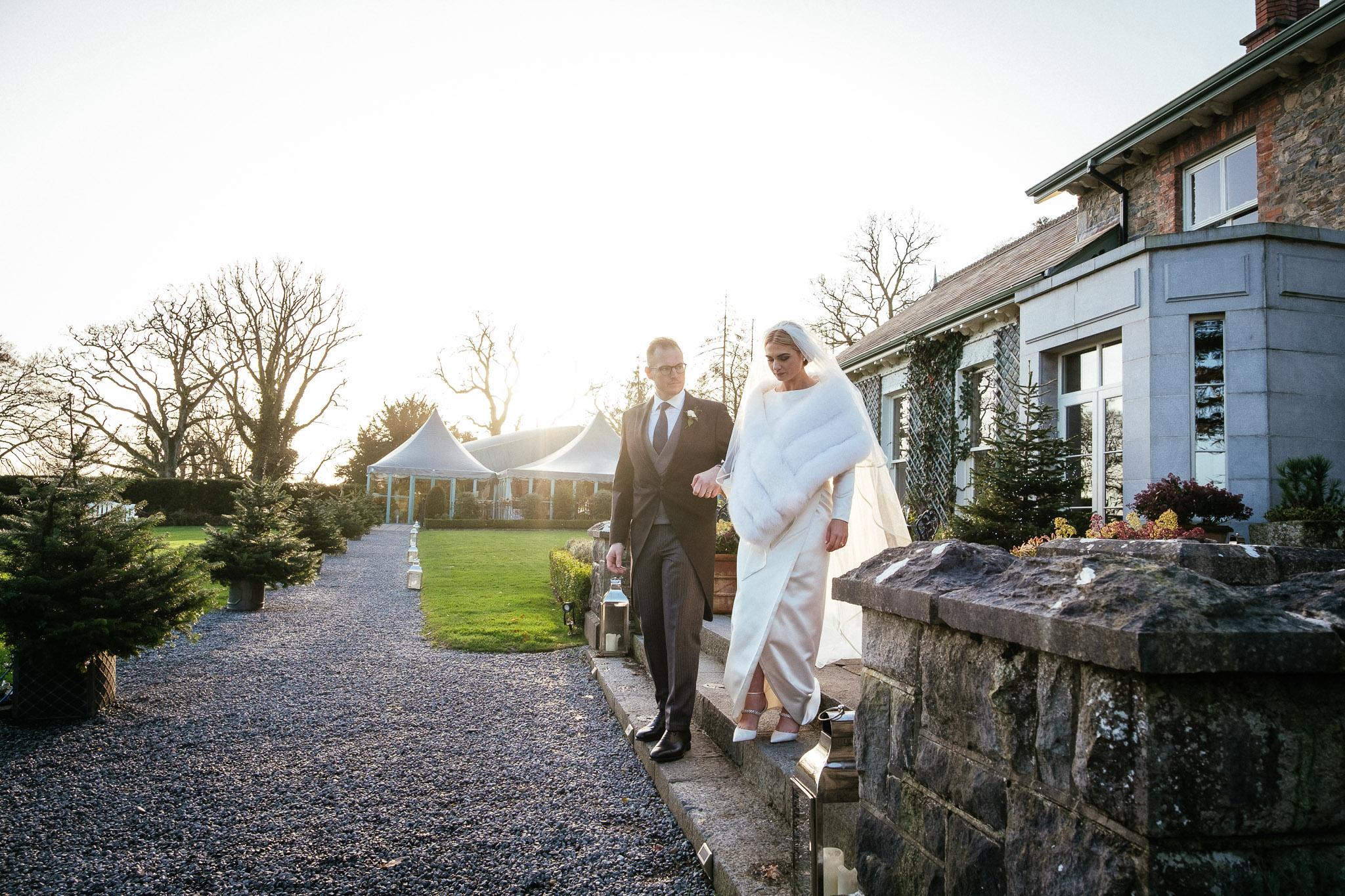 bride and groom walking at Virginia Park Lodge wedding