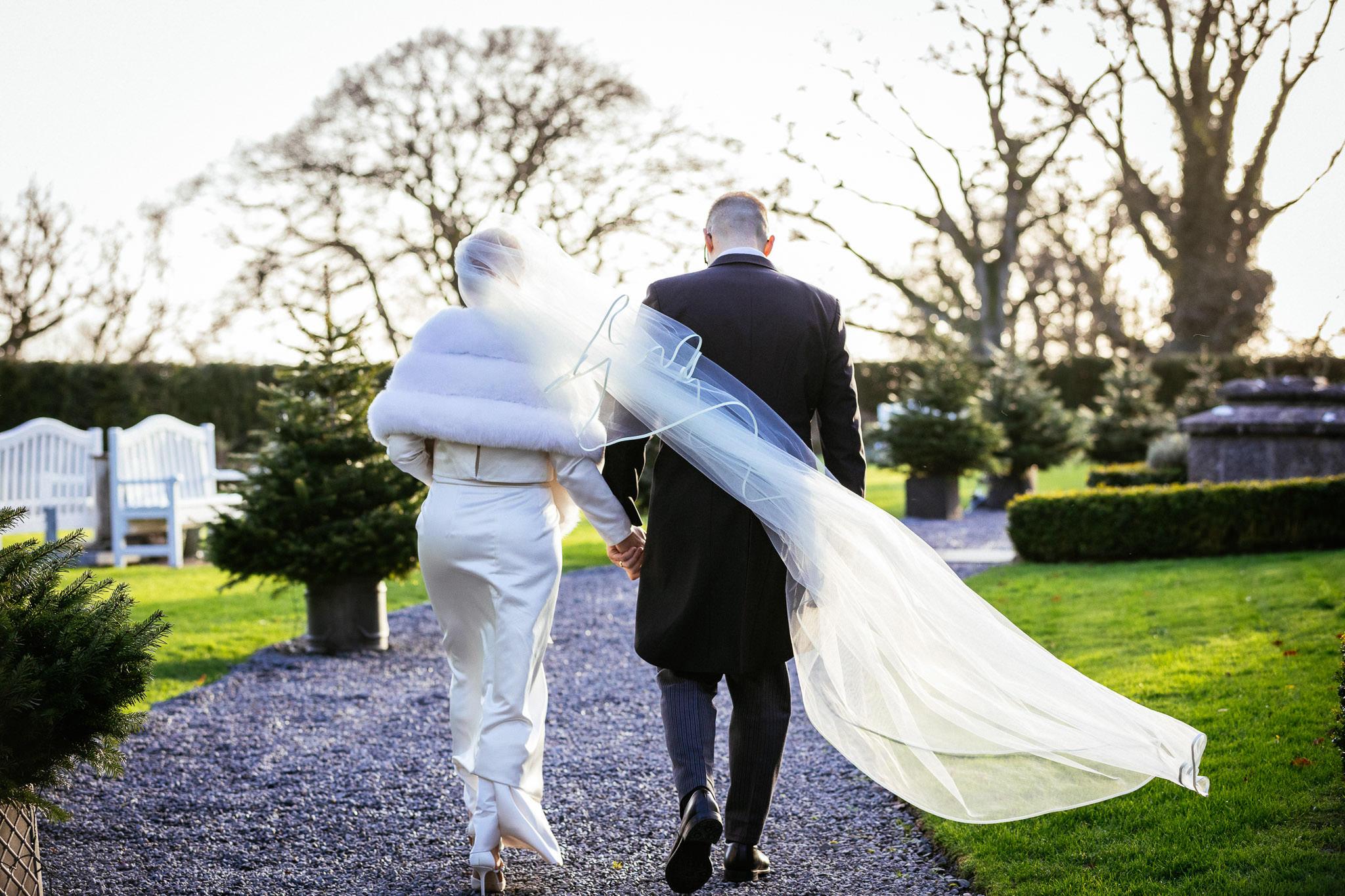 bride and groom walking towards setting sun at at Virginia Park Lodge