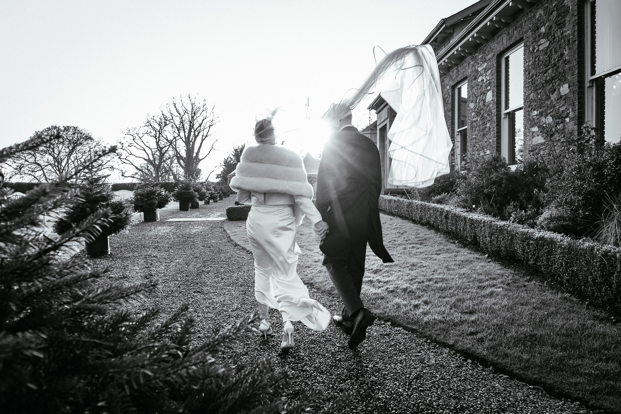 bride and groom walking into sunset at Virginia Park Lodge wedding