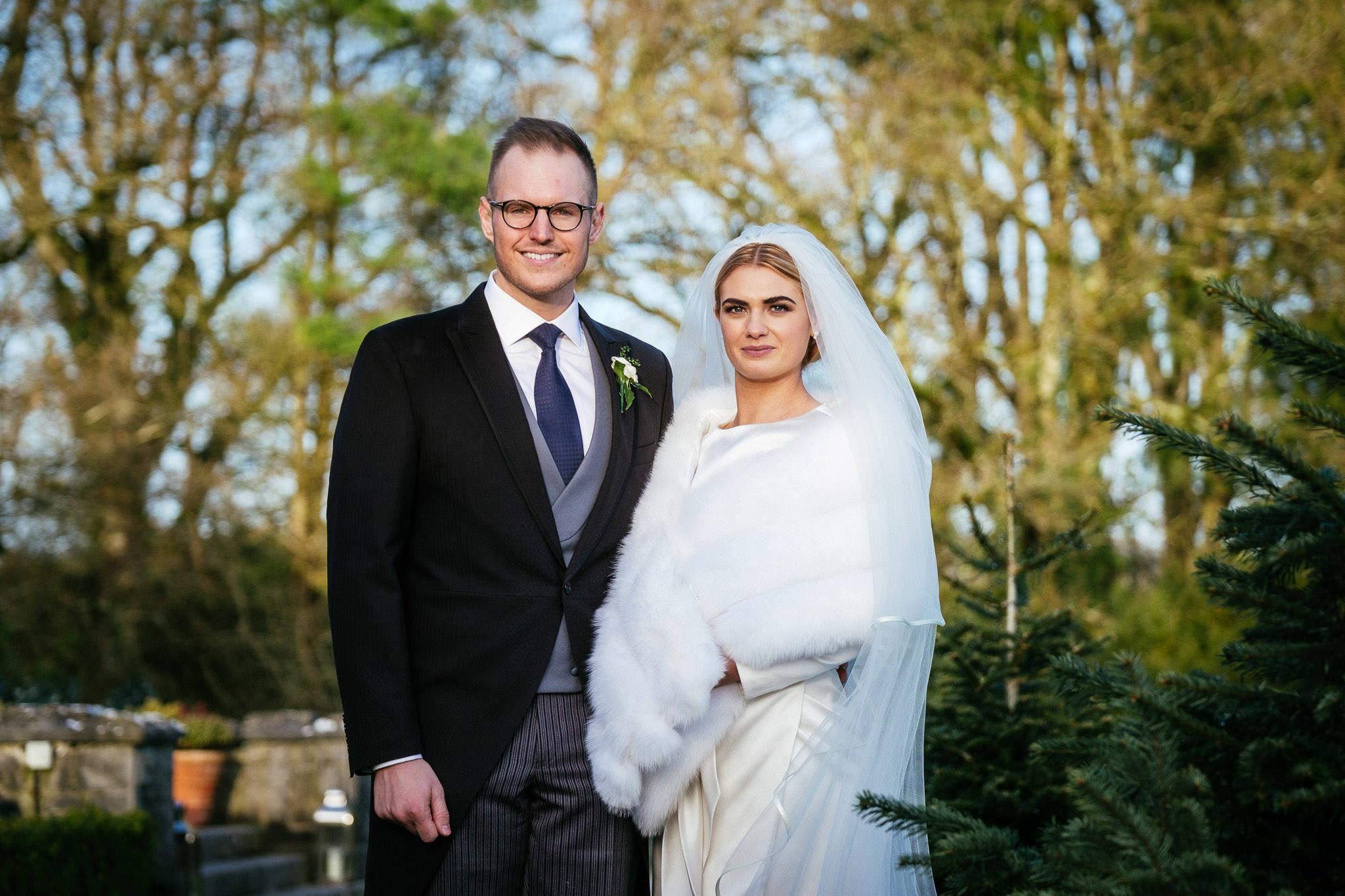 bride and groom looking at camera at Virginia Park Lodge wedding