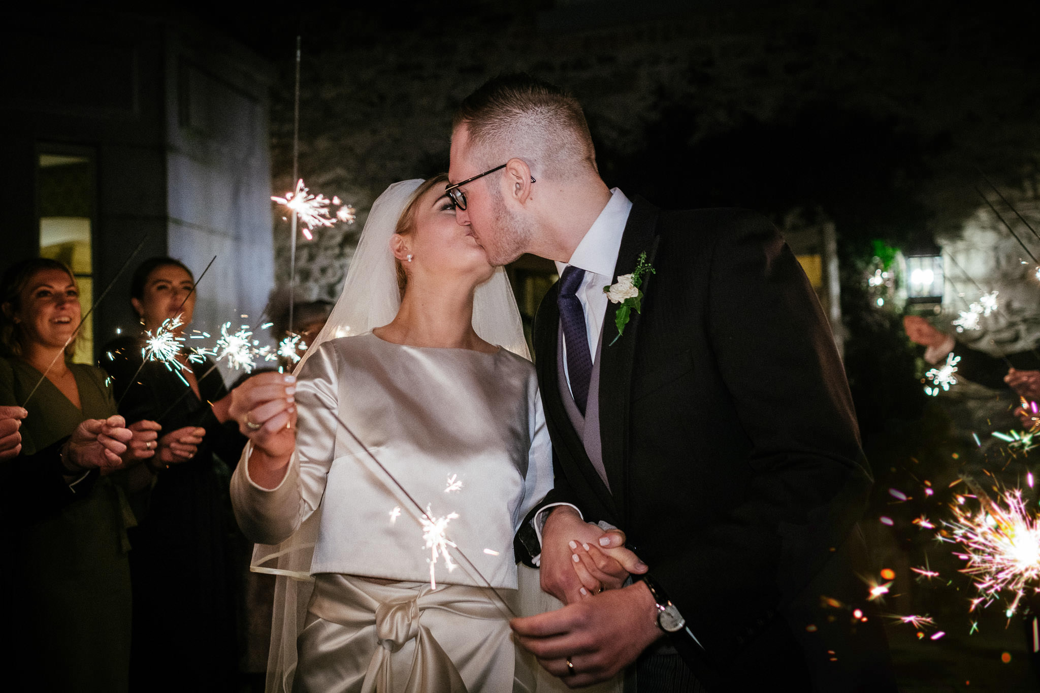 bride and groom kissing during sparkler shot at Virginia Park Lodge wedding