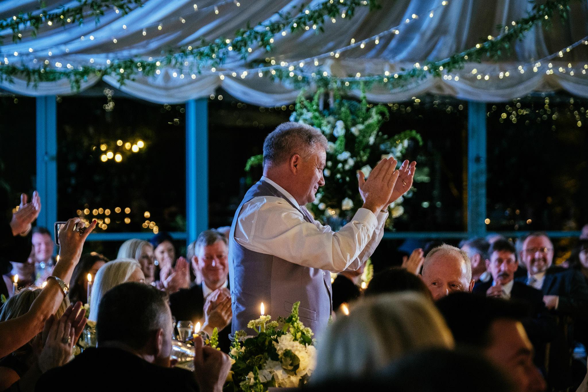 man applauding a speech at Virginia Park Lodge wedding