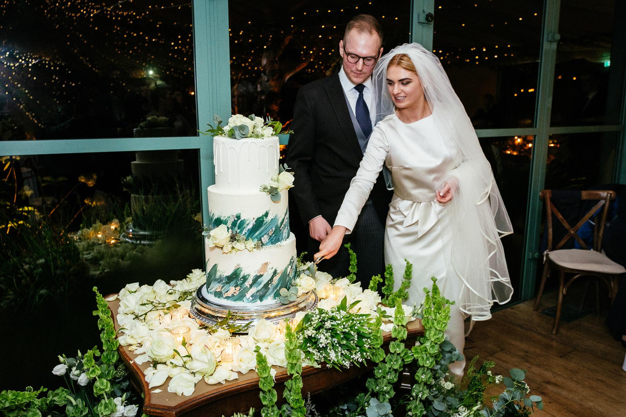 bride and groom cutting cake at Virginia Park Lodge wedding