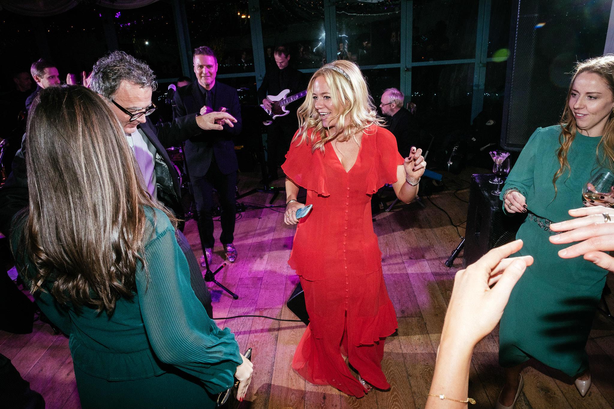 girl in red dress dancing at Virginia Park Lodge wedding