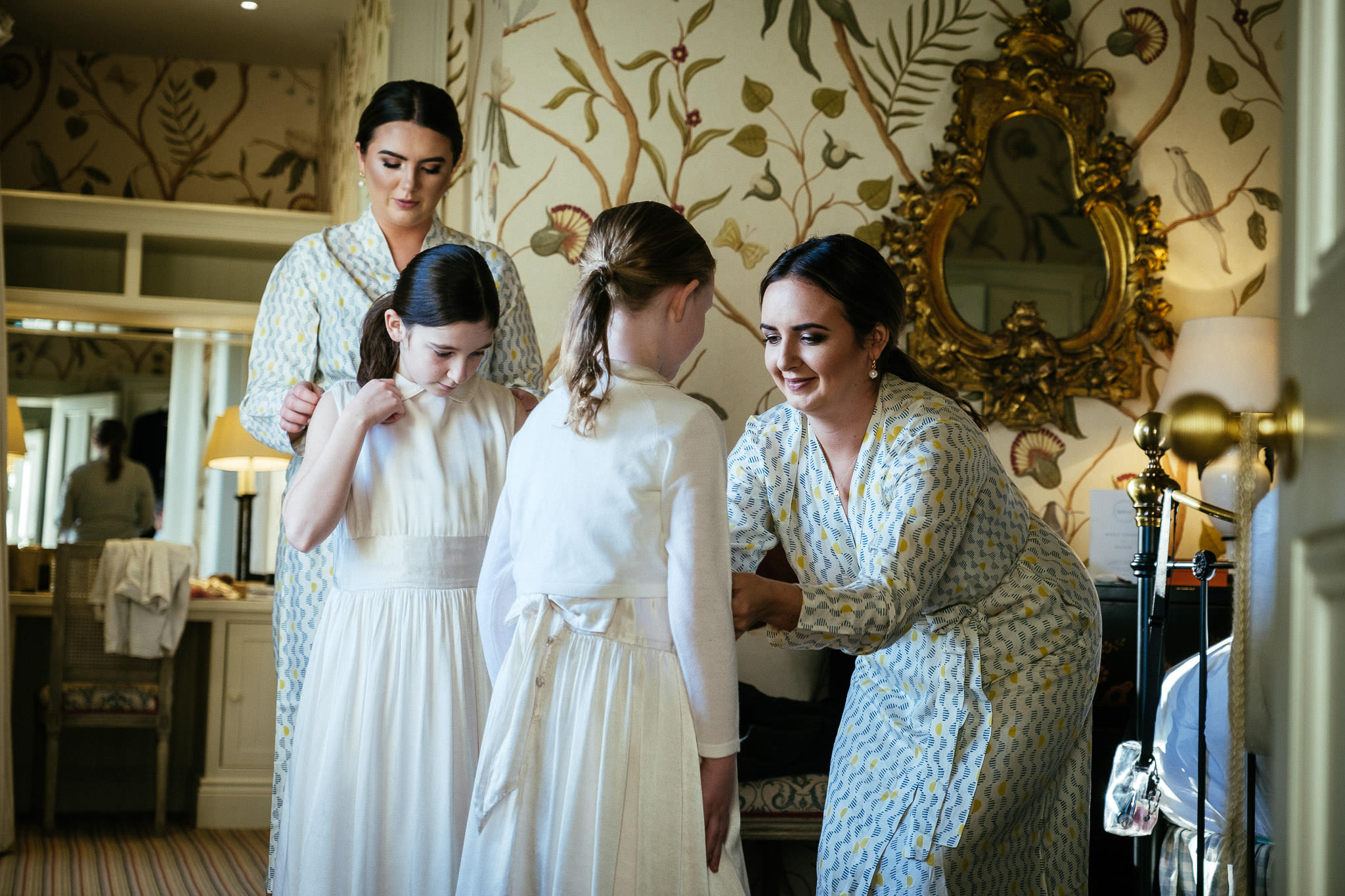 flowergirls getting dressed at virginia park lodge wedding