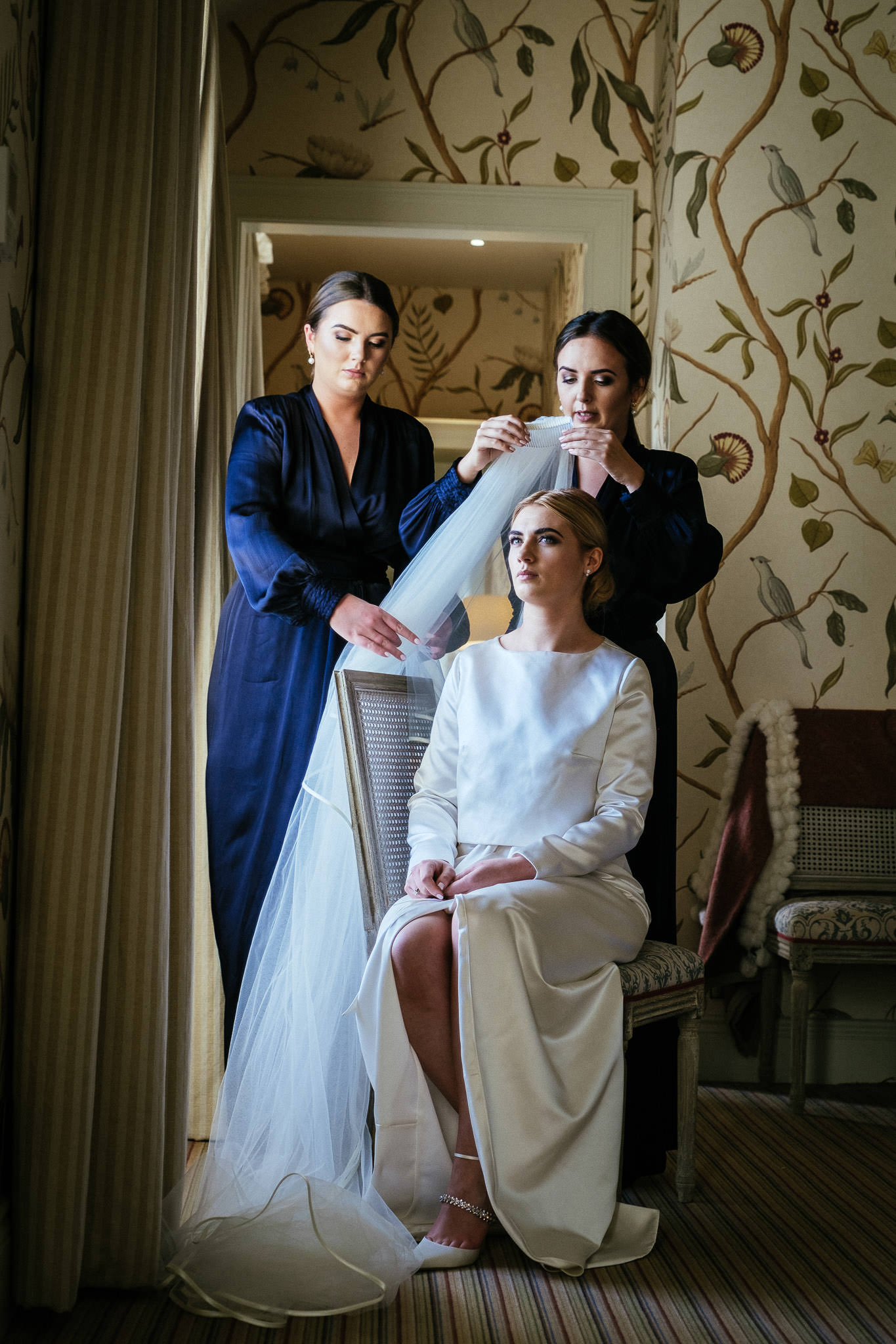 bride having her veil placed on her head at virginia park lodge wedding