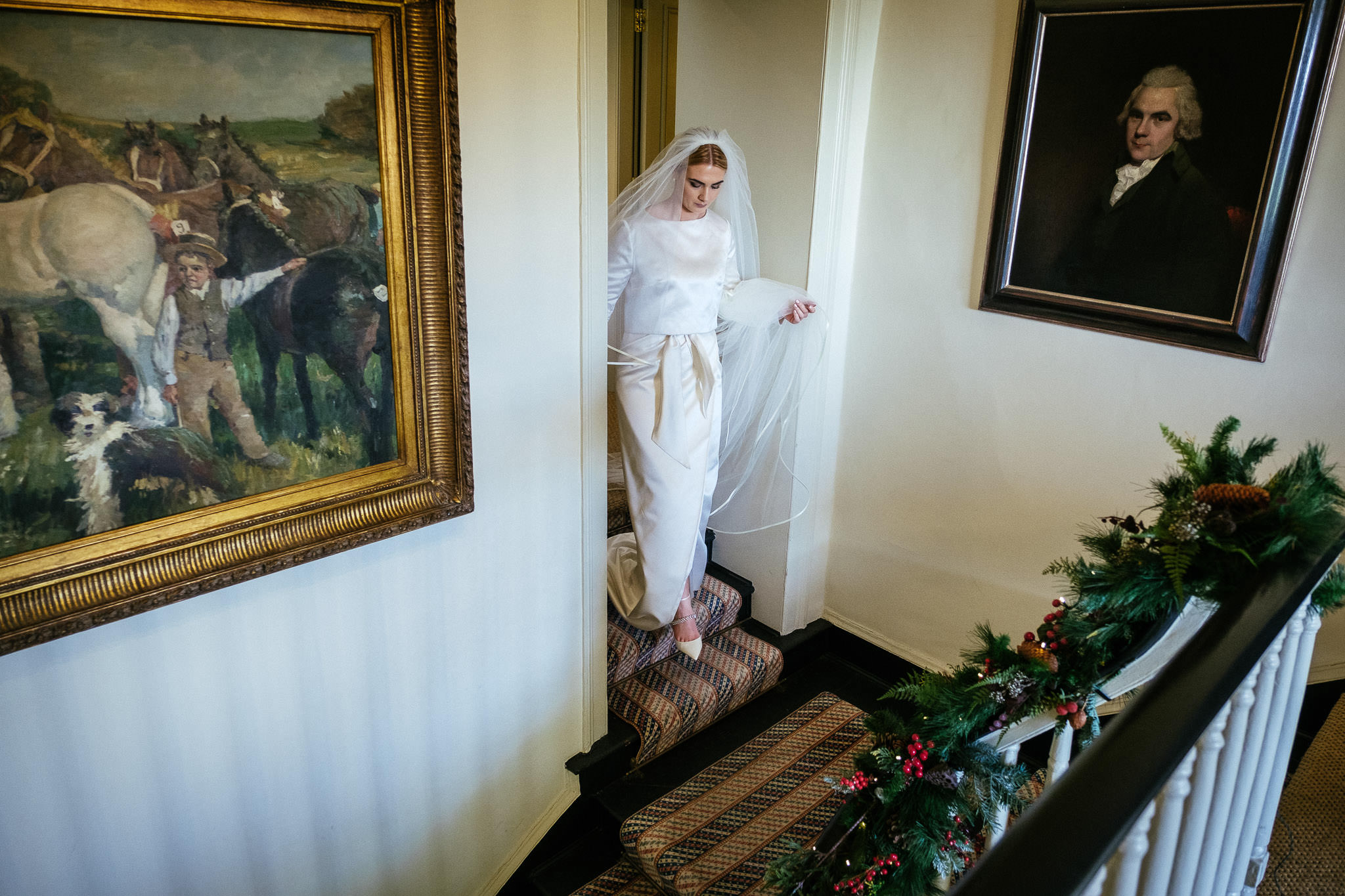 bride walking down stairs to go to church at virginia park lodge wedding