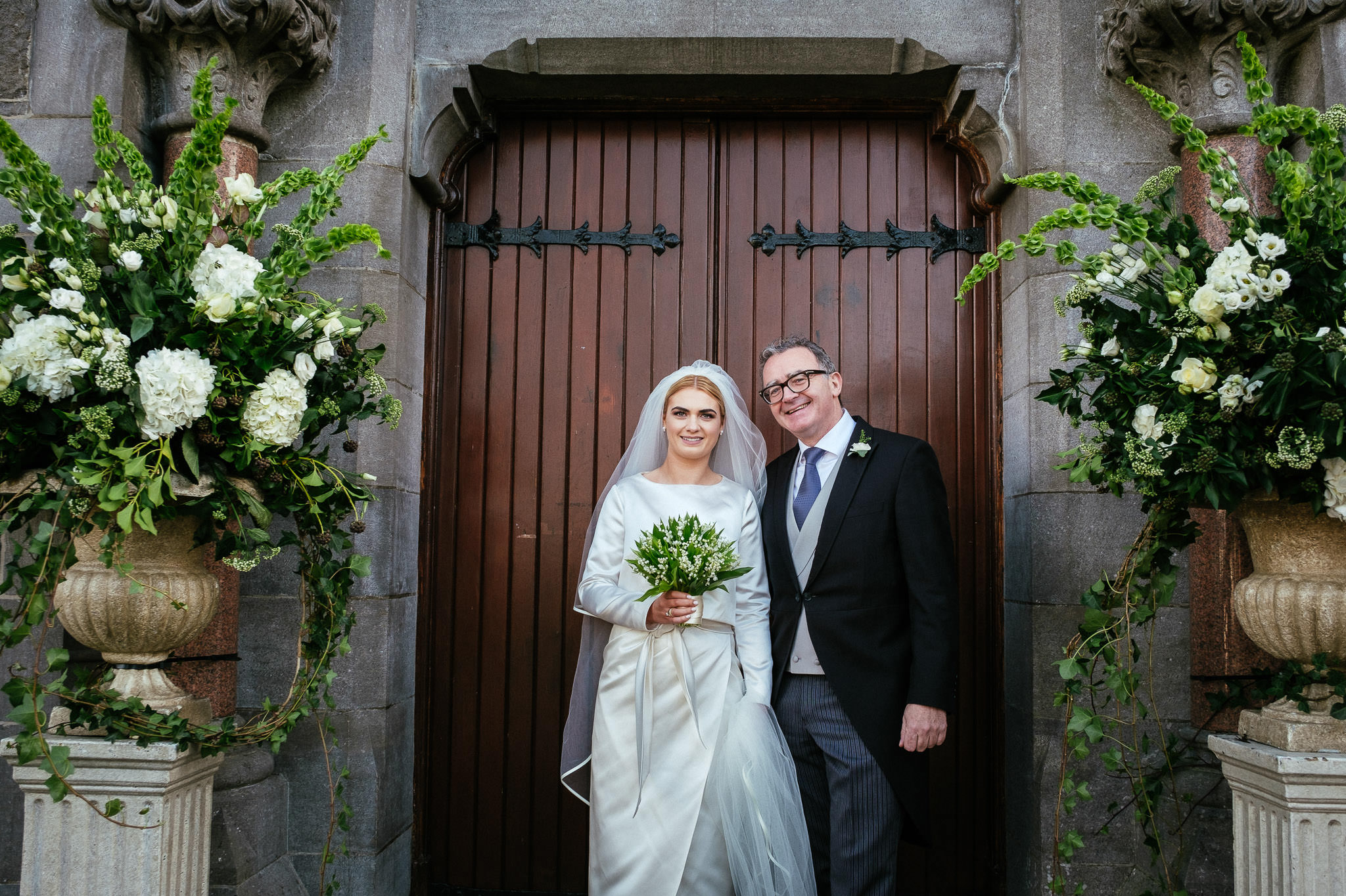 bride with her father in front of St Brigid's church Oldcastle Co Cavan