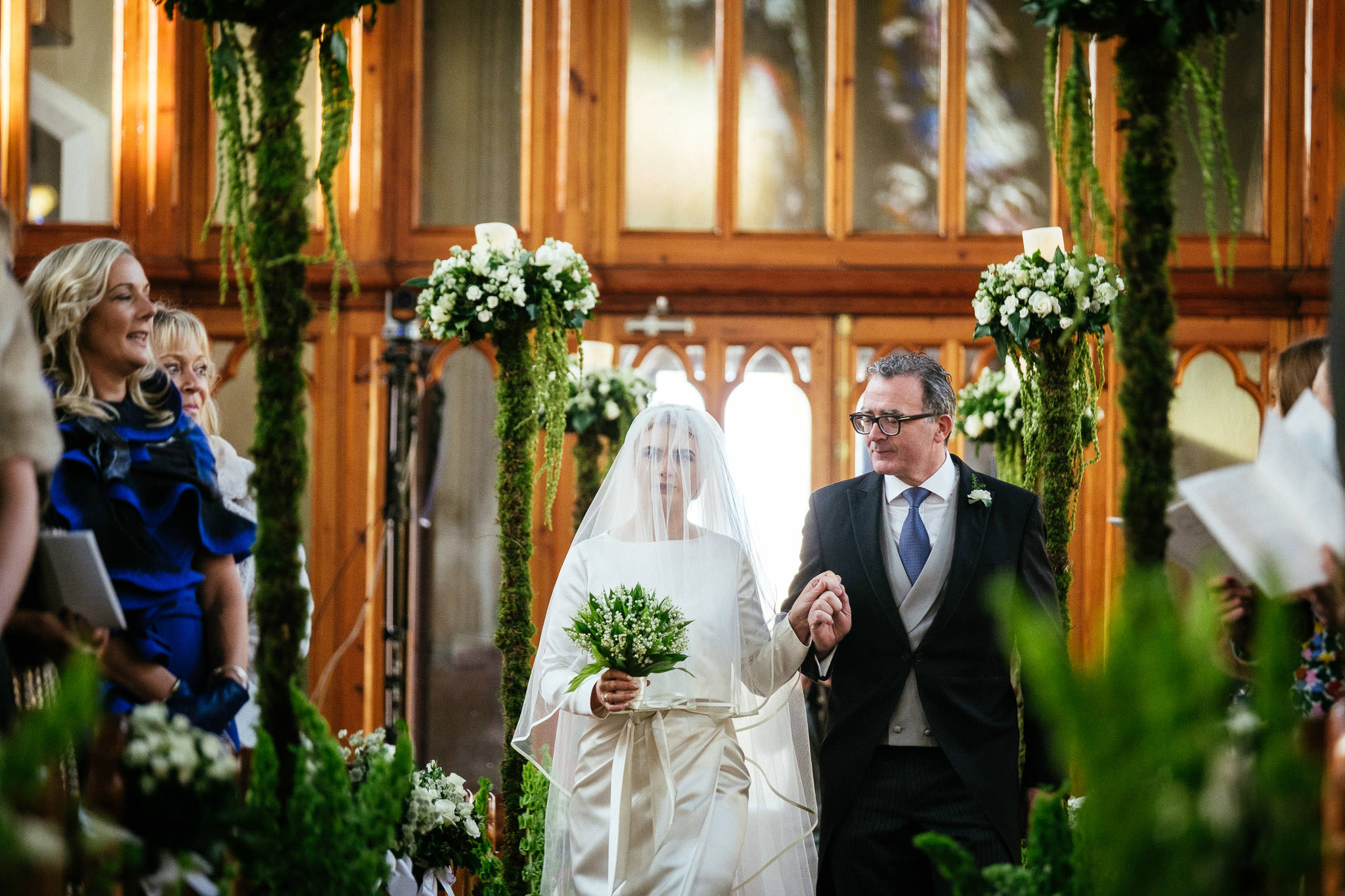 father looking at bride as he walks her up the aisle in St Brigid's Church Oldcastle