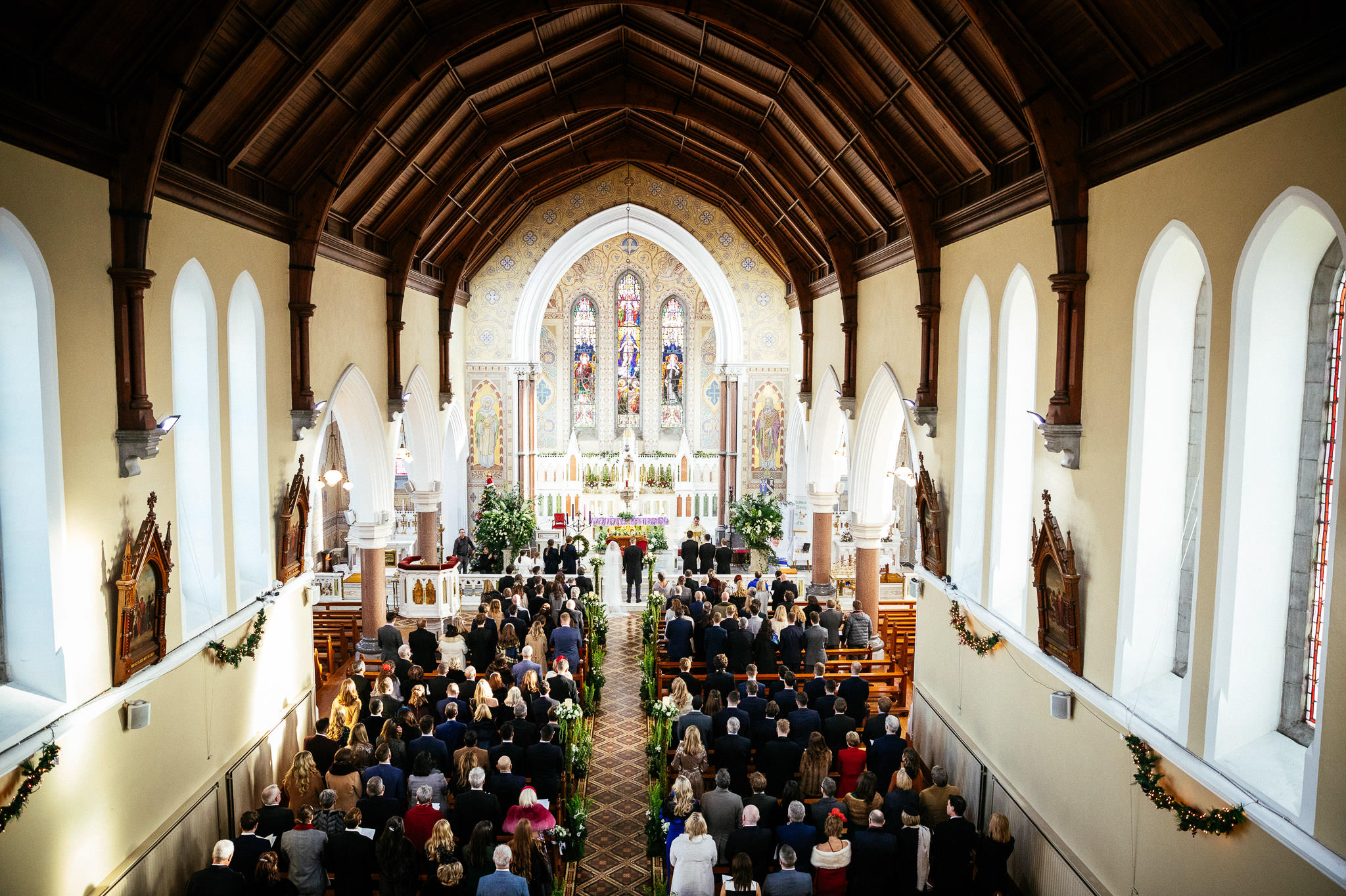 gallery view of congregation during wedding ceremony at St Brigid's Church Oldcastle