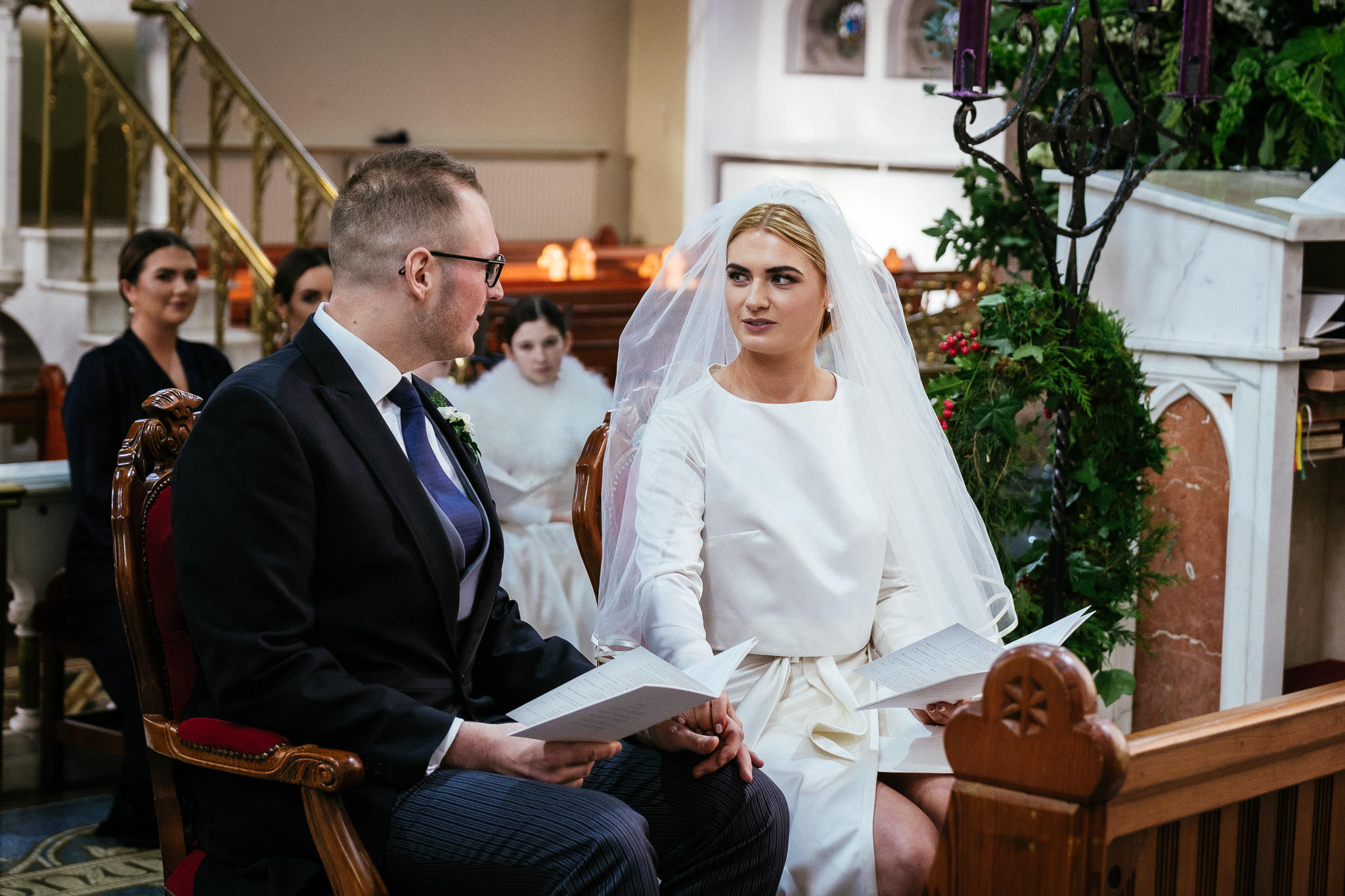 bride and groom exchanging glances during wedding ceremony at St Brigid's Church Oldcastle