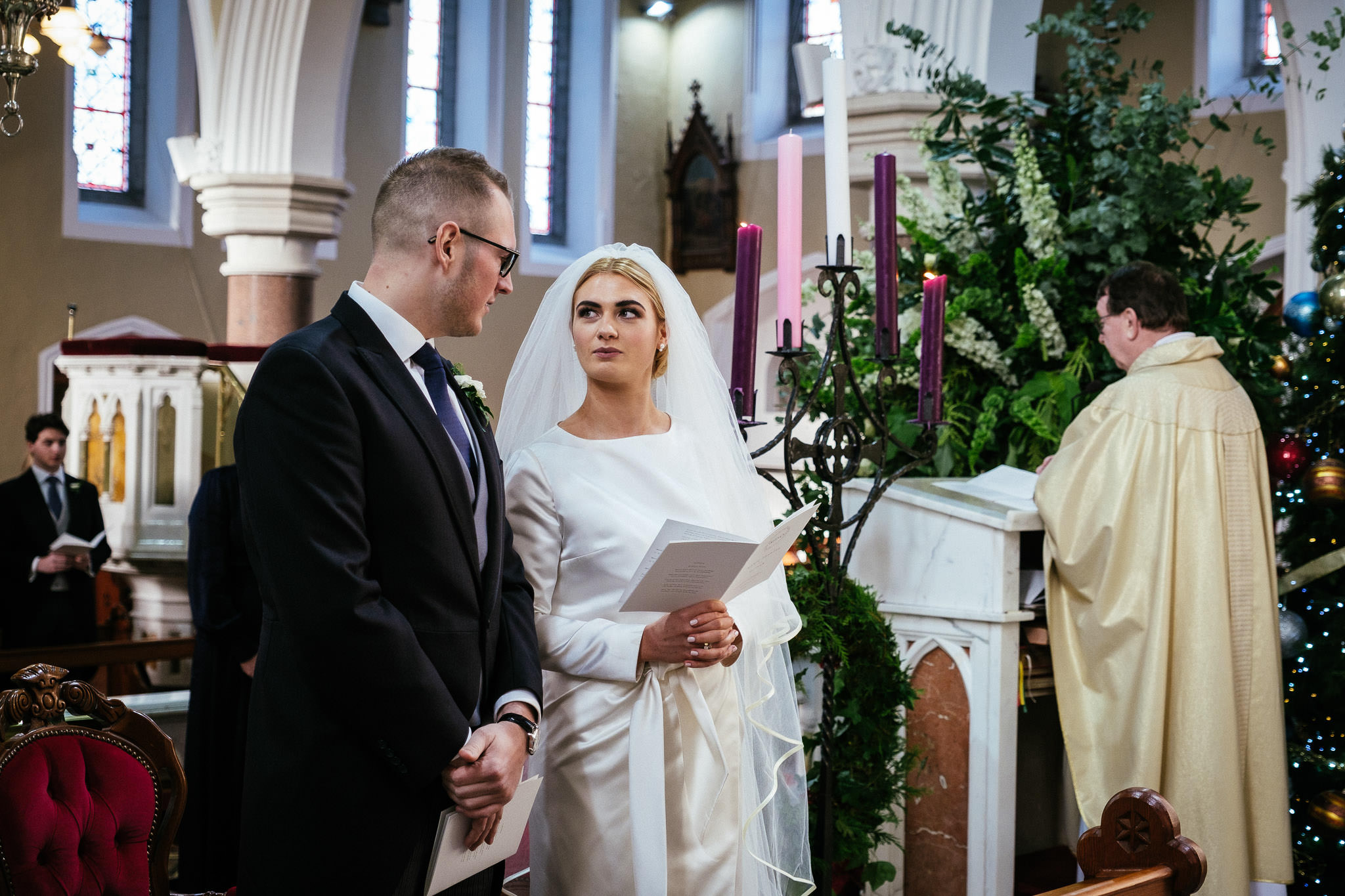 bride looking at groom during wedding ceremony at St Brigid's Church Oldcastle