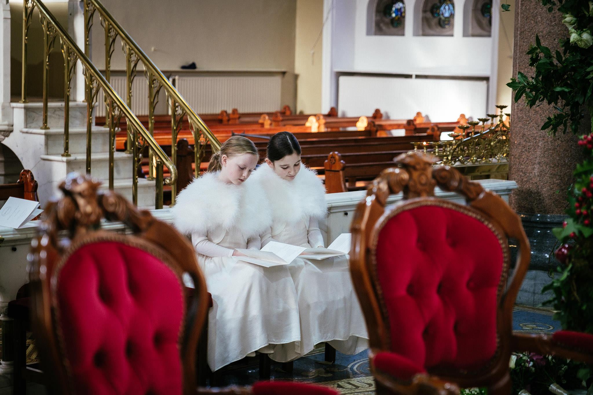 flowergirls during wedding ceremony at St Brigid's Church Oldcastle
