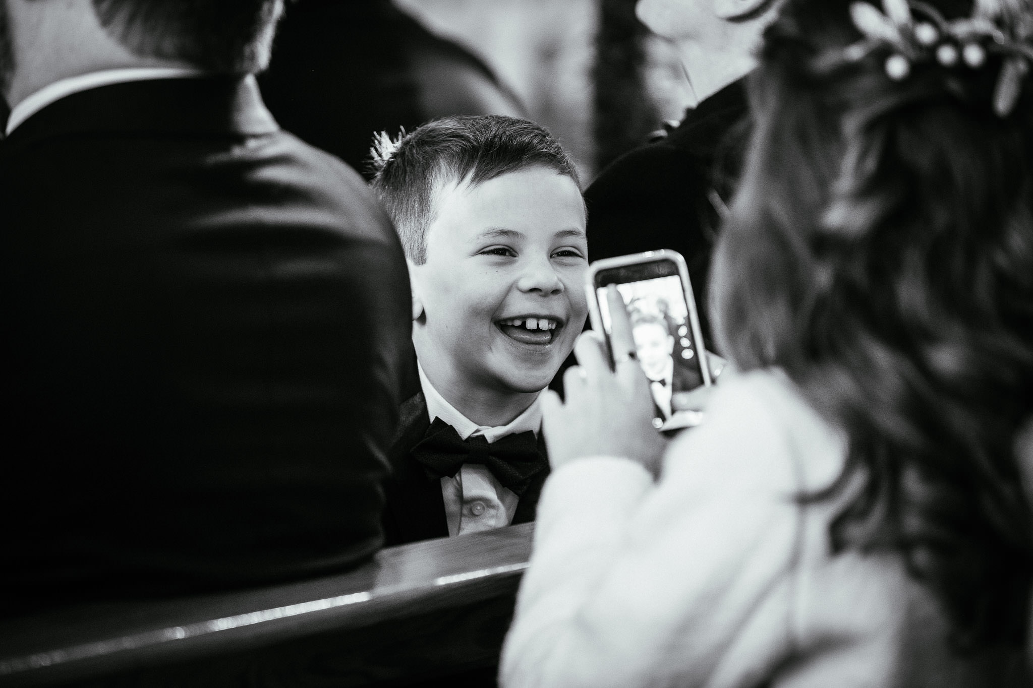 kid laughing during wedding ceremony at St Brigid's Church Oldcastle