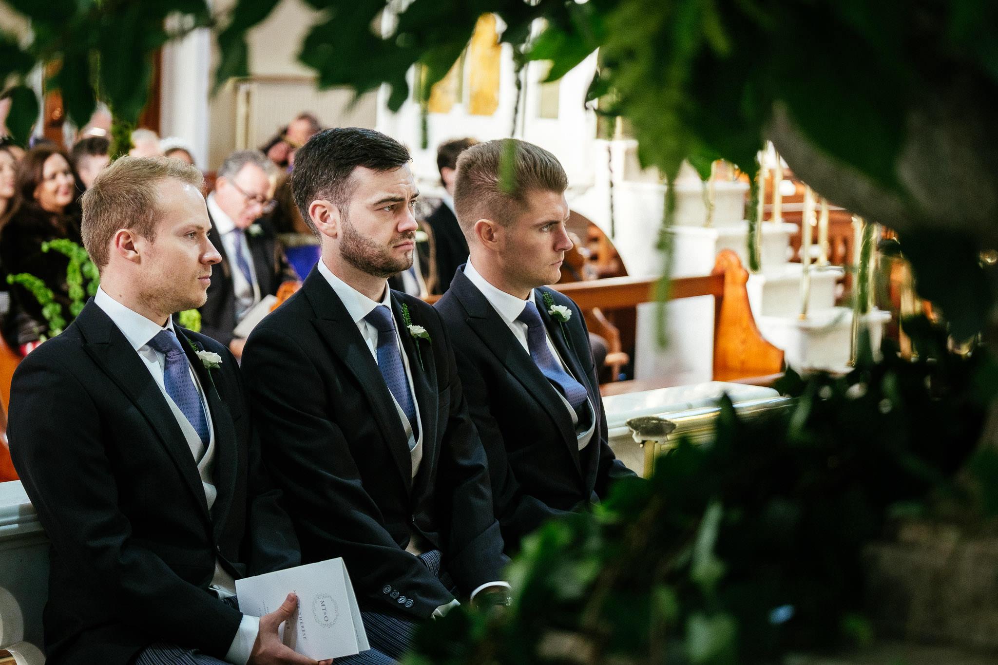 groomsmen during wedding ceremony at St Brigid's Church Oldcastle
