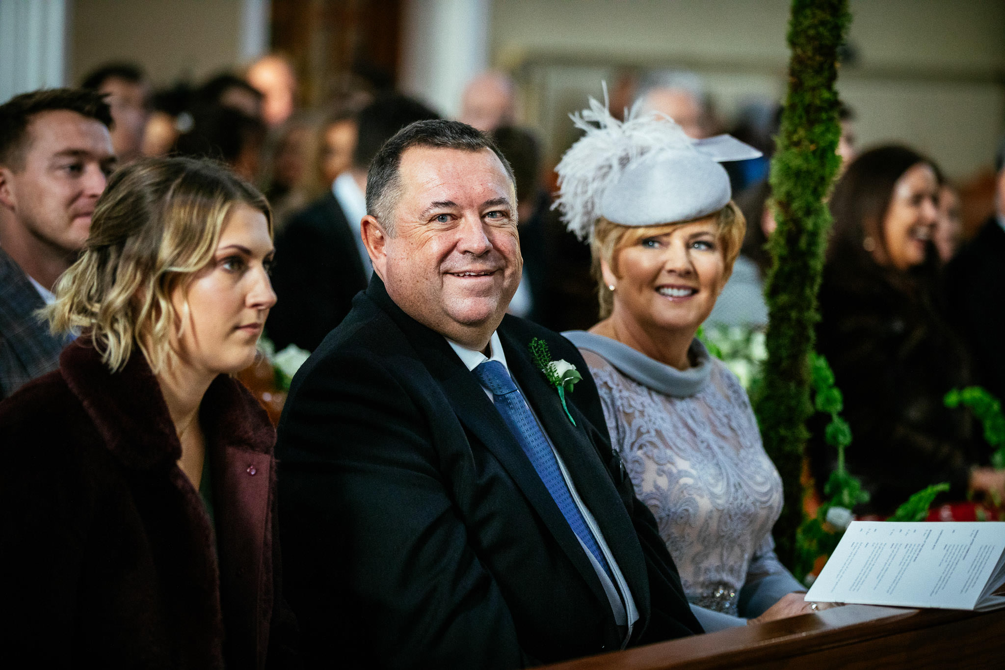 grooms family laughing during wedding ceremony at St Brigid's Church Oldcastle