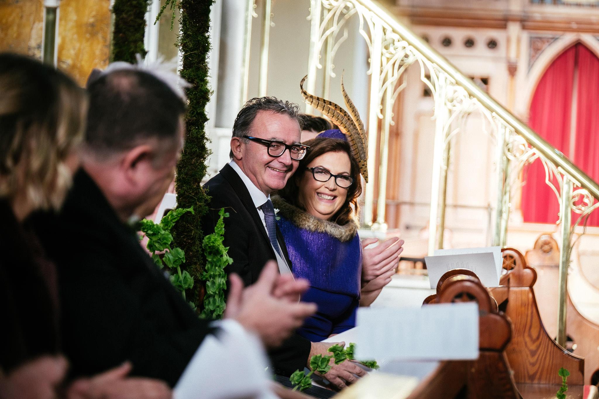 brides parents laughing