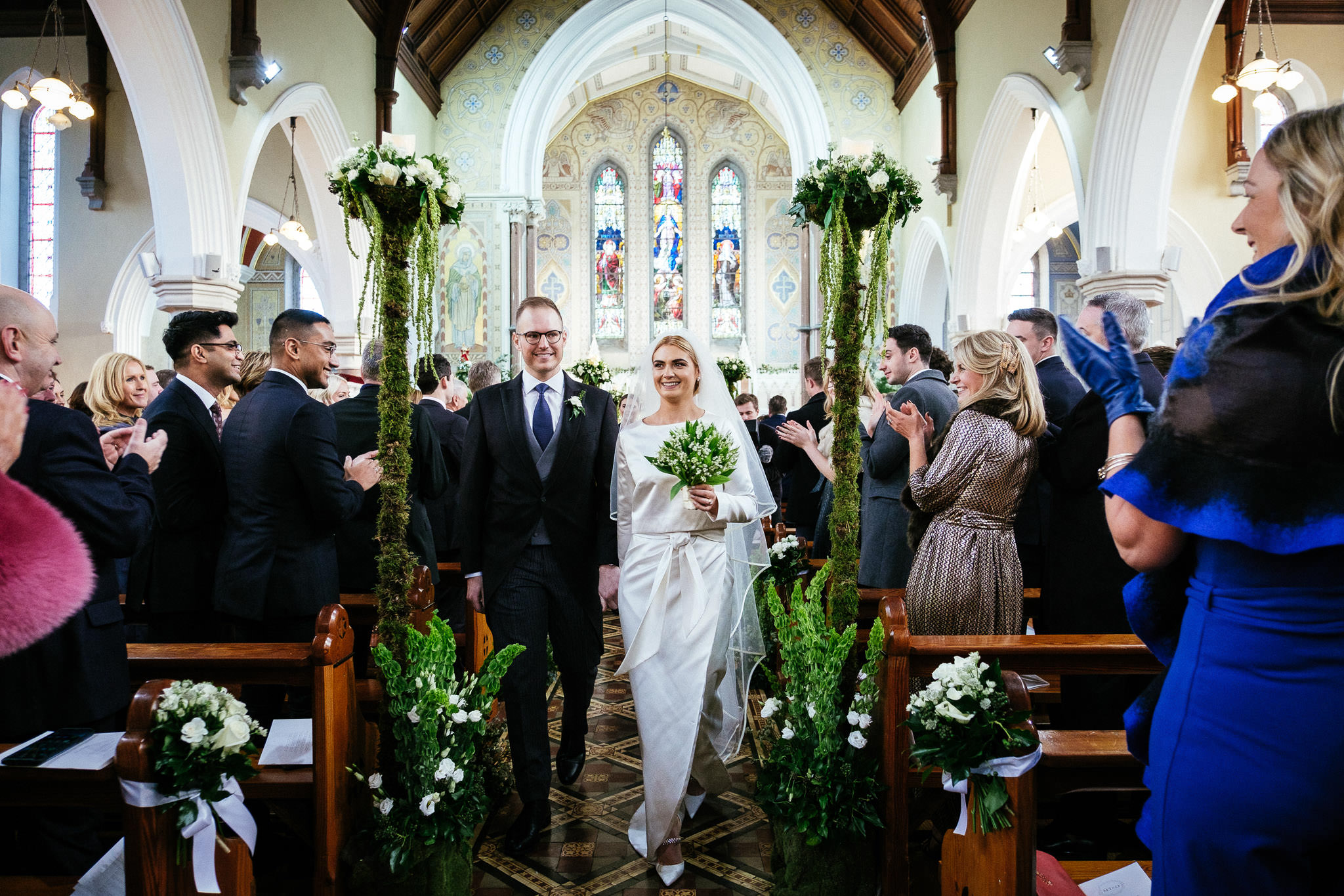bride and groom walking down aisle after their wedding ceremony at St Brigid's Church Oldcastle