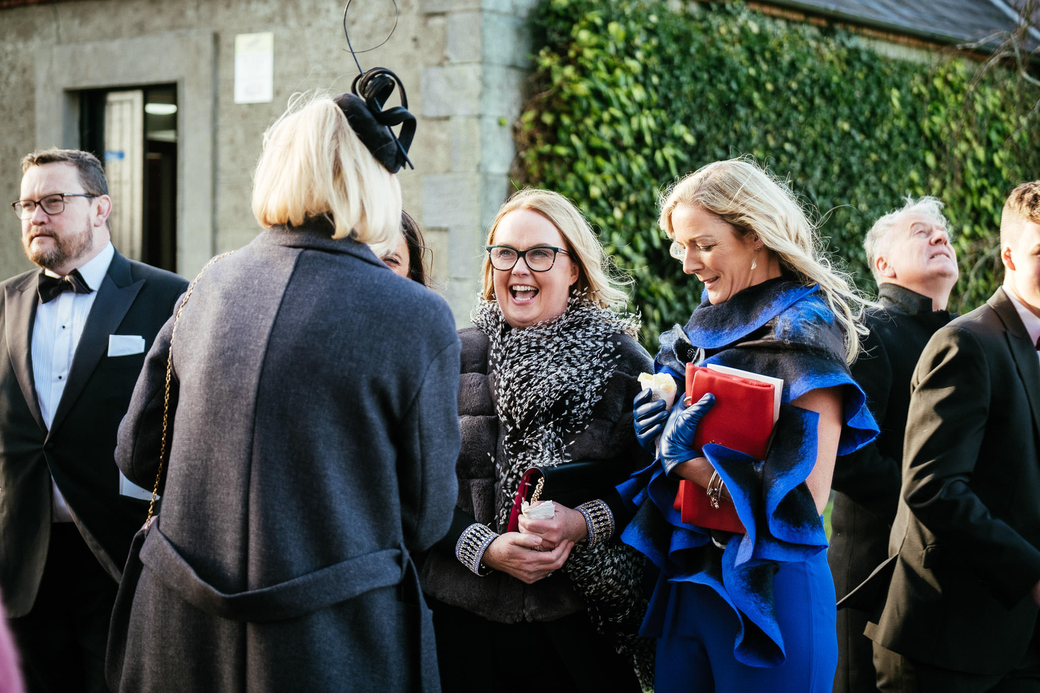 wedding guests laughing after their wedding ceremony at St Brigid's Church Oldcastle