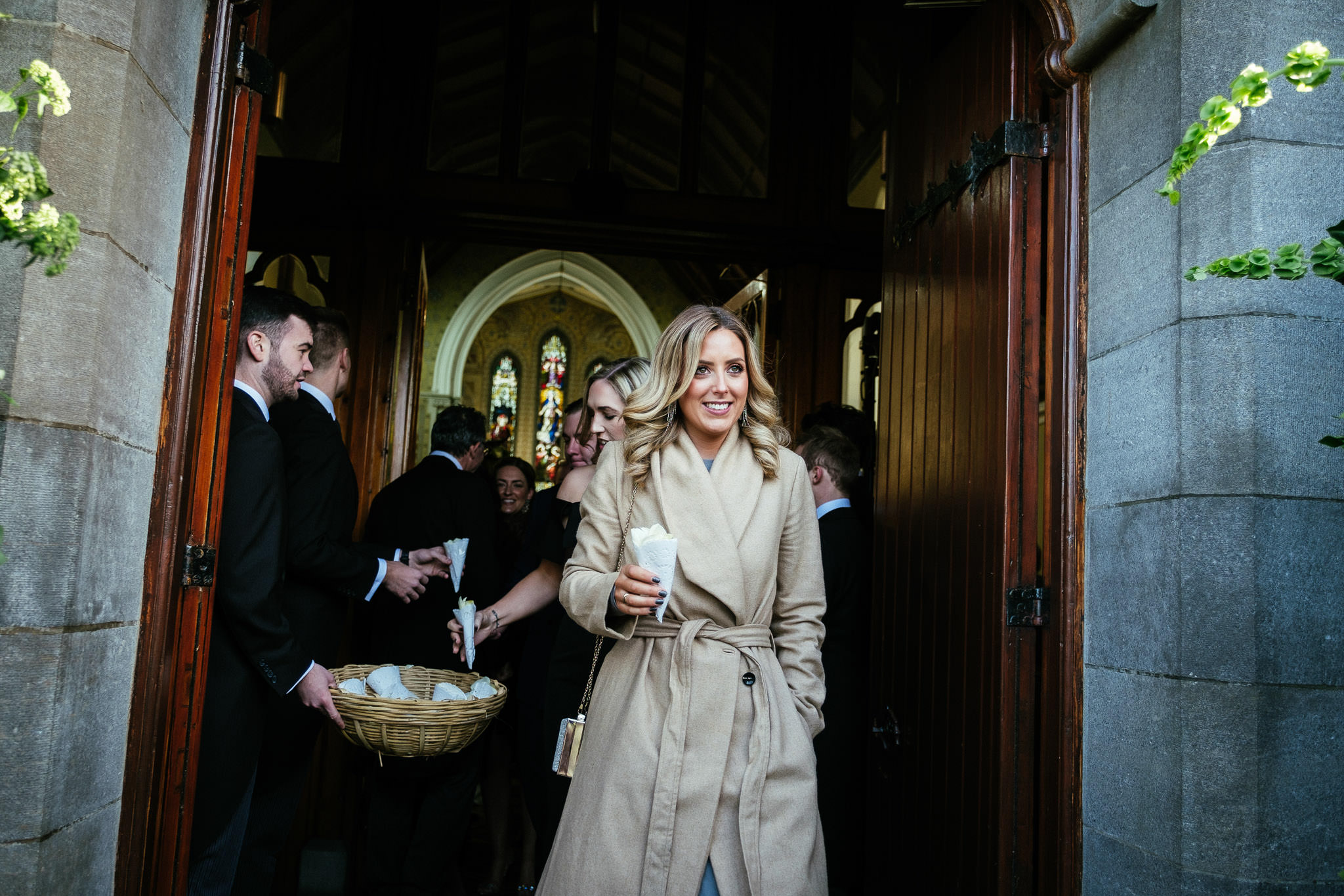 female guest leaving church after a wedding ceremony at St Brigid's Church Oldcastle