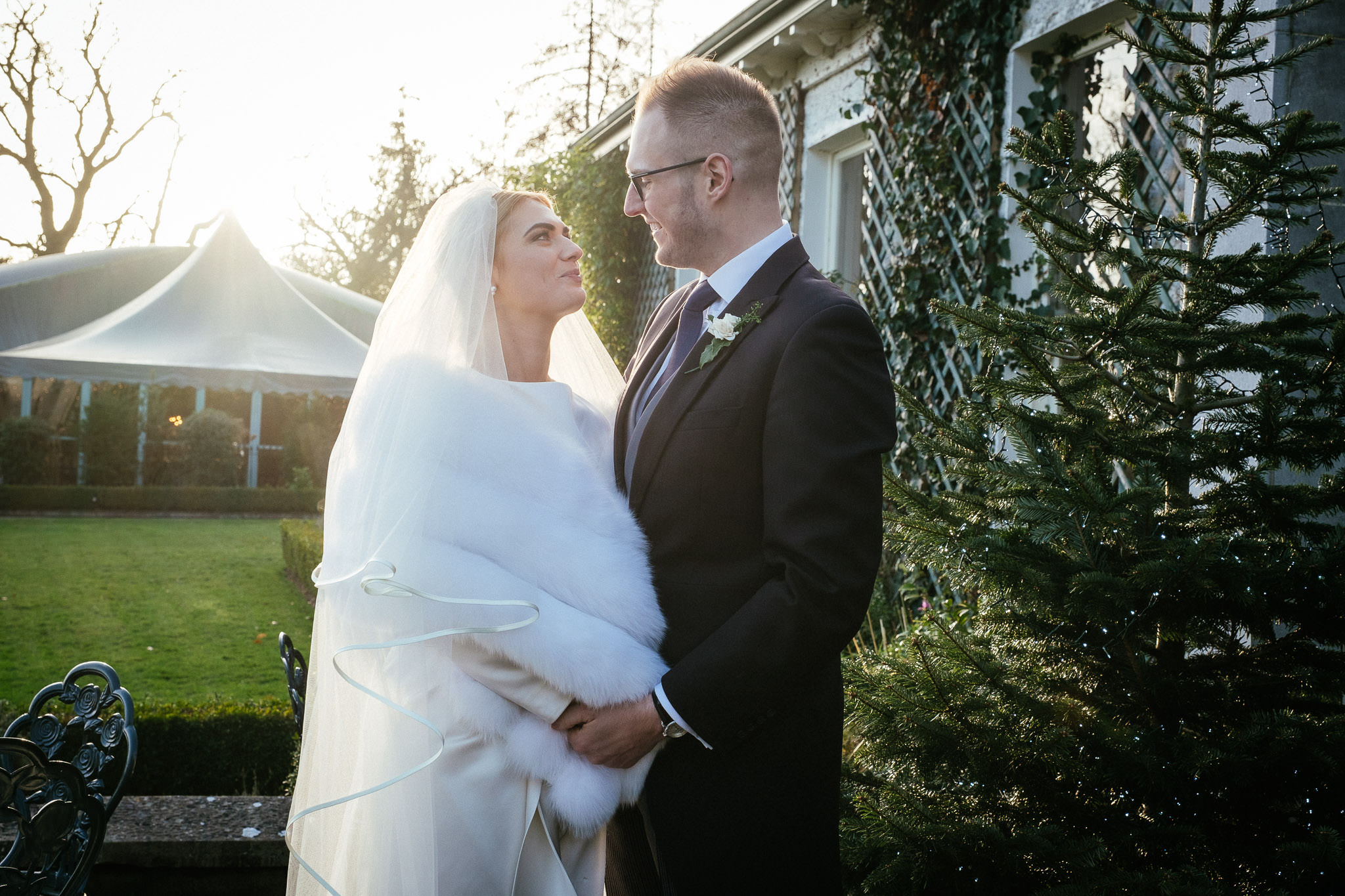 bride and groom with setting sun behind them at Virginia Park Lodge wedding