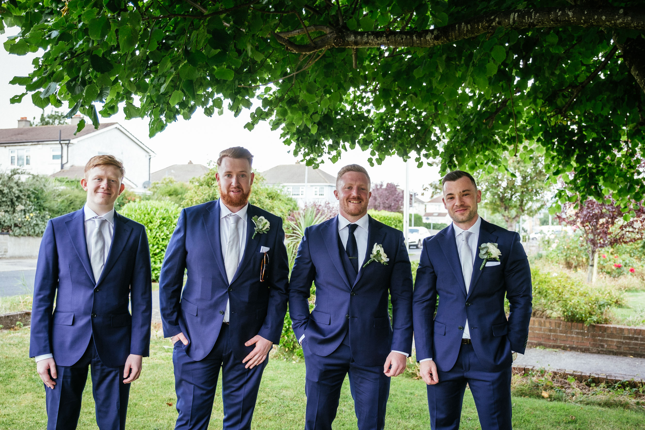 groom and groomsmen standing outside the church at St Dominic Parish, Tallaght