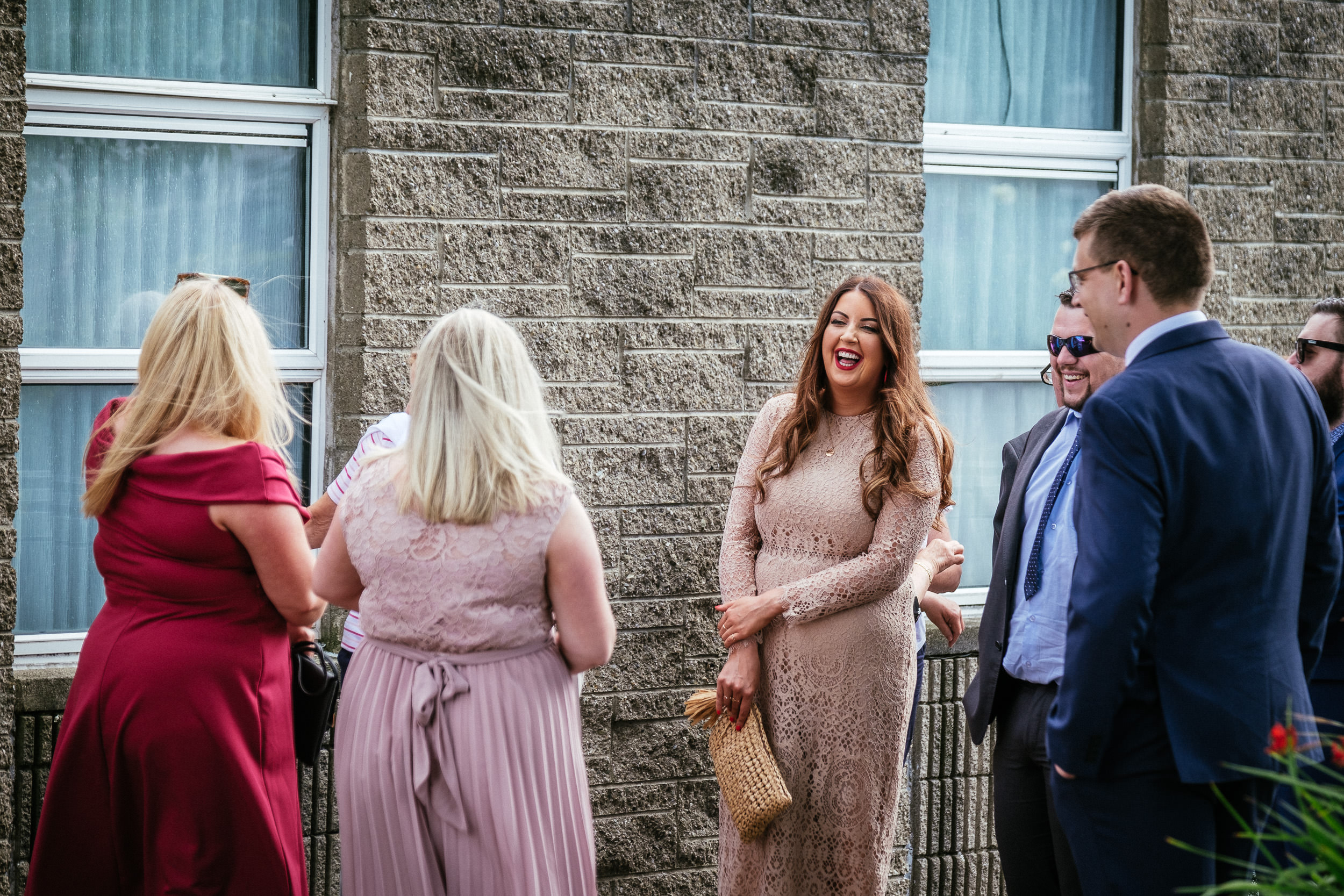 wedding guests laughing at St Dominic Parish, Tallaght