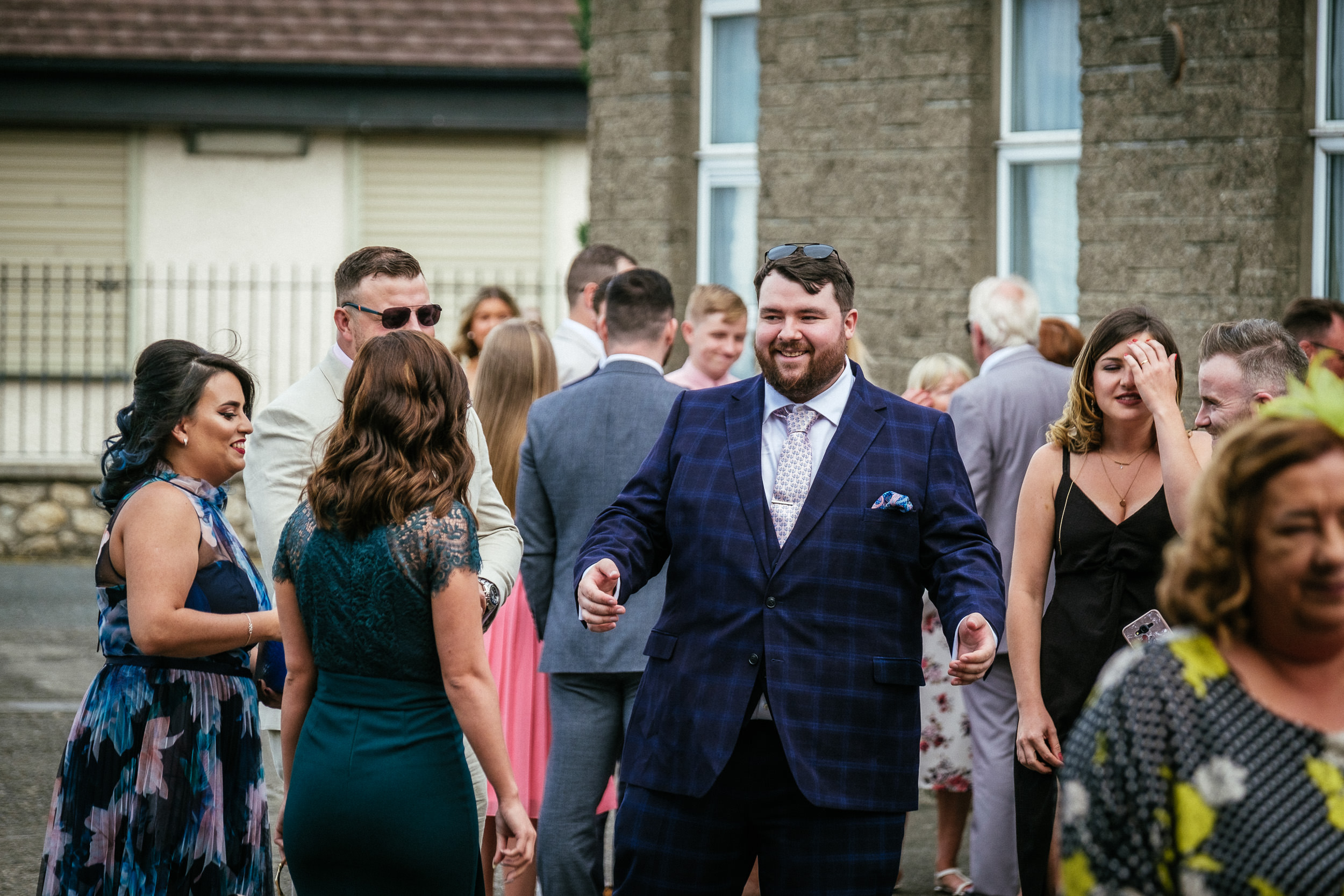 groomsman laughing at St Dominic Parish, Tallaght