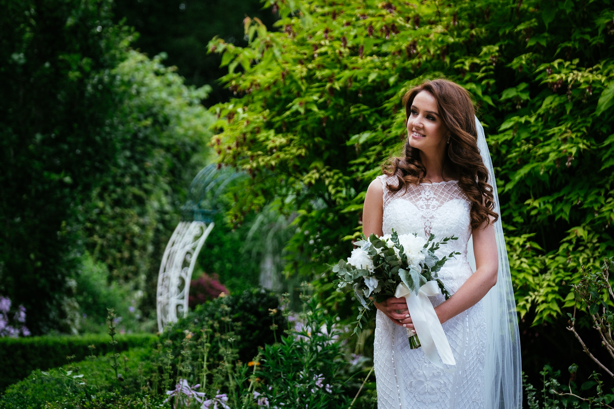 bride posing with bouquet aat her killashee house hotel wedding