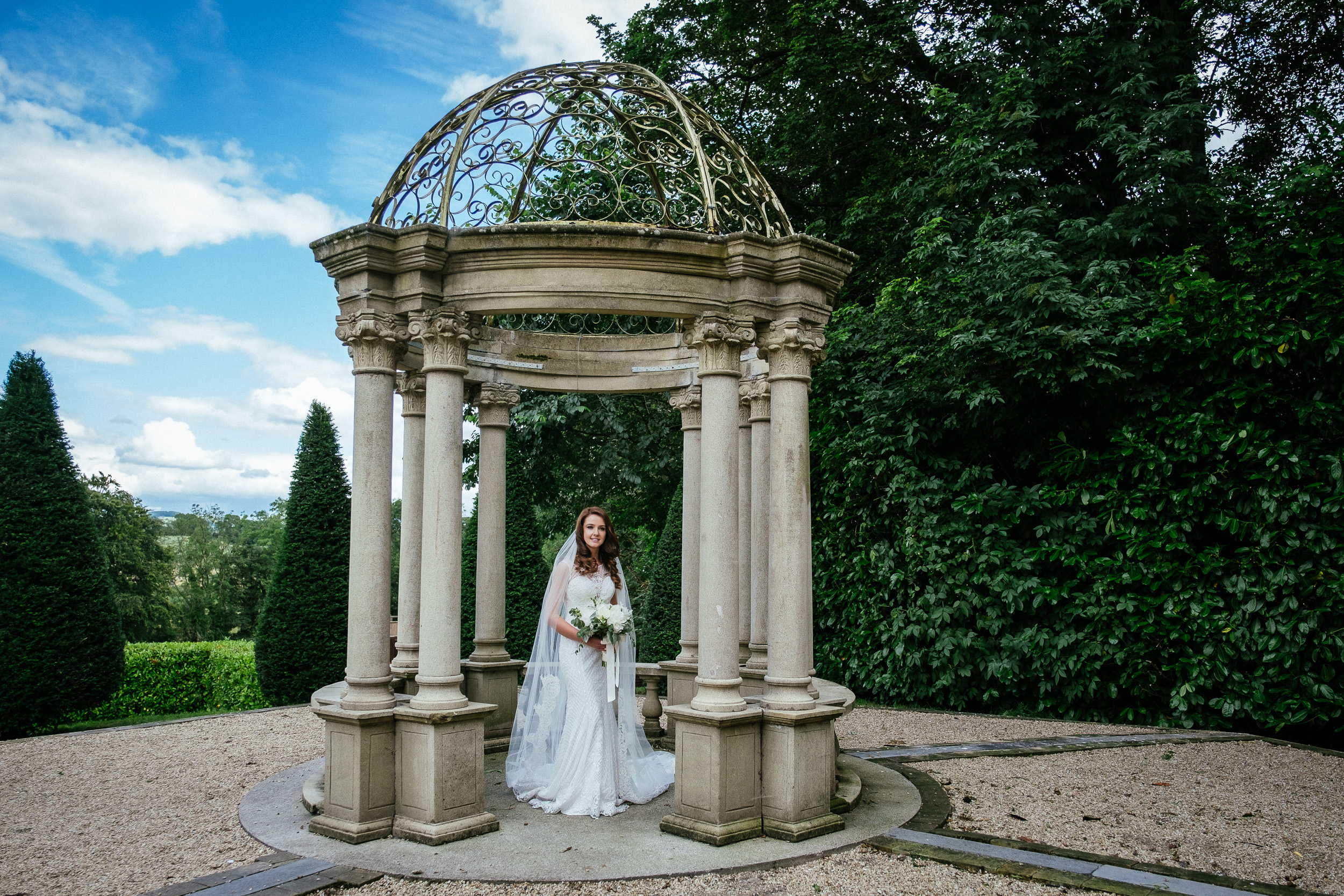 bride posing in the butterfly garden at her killashee house hotel wedding
