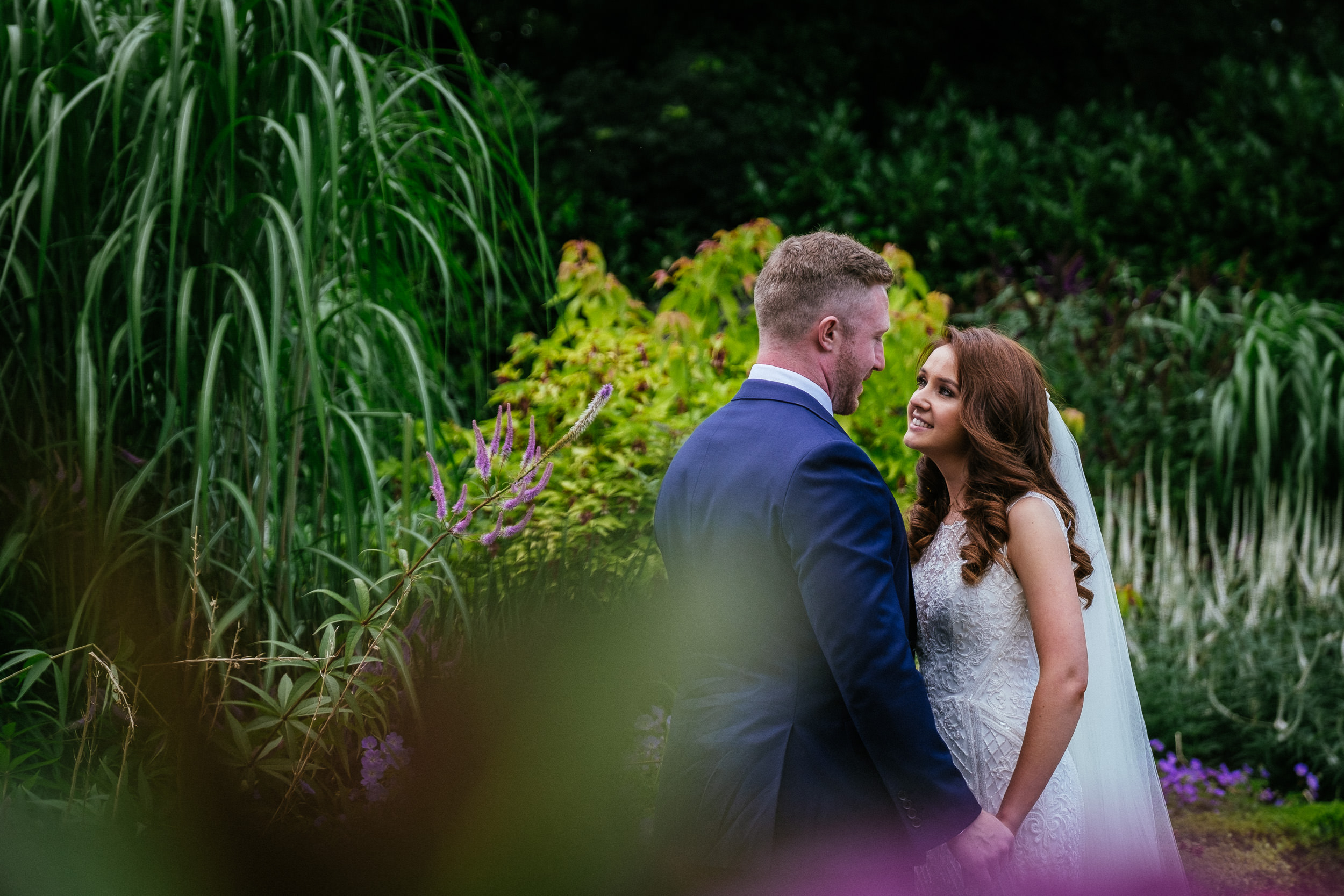 bride and groom in butterfly garden at killashee house hotel wedding